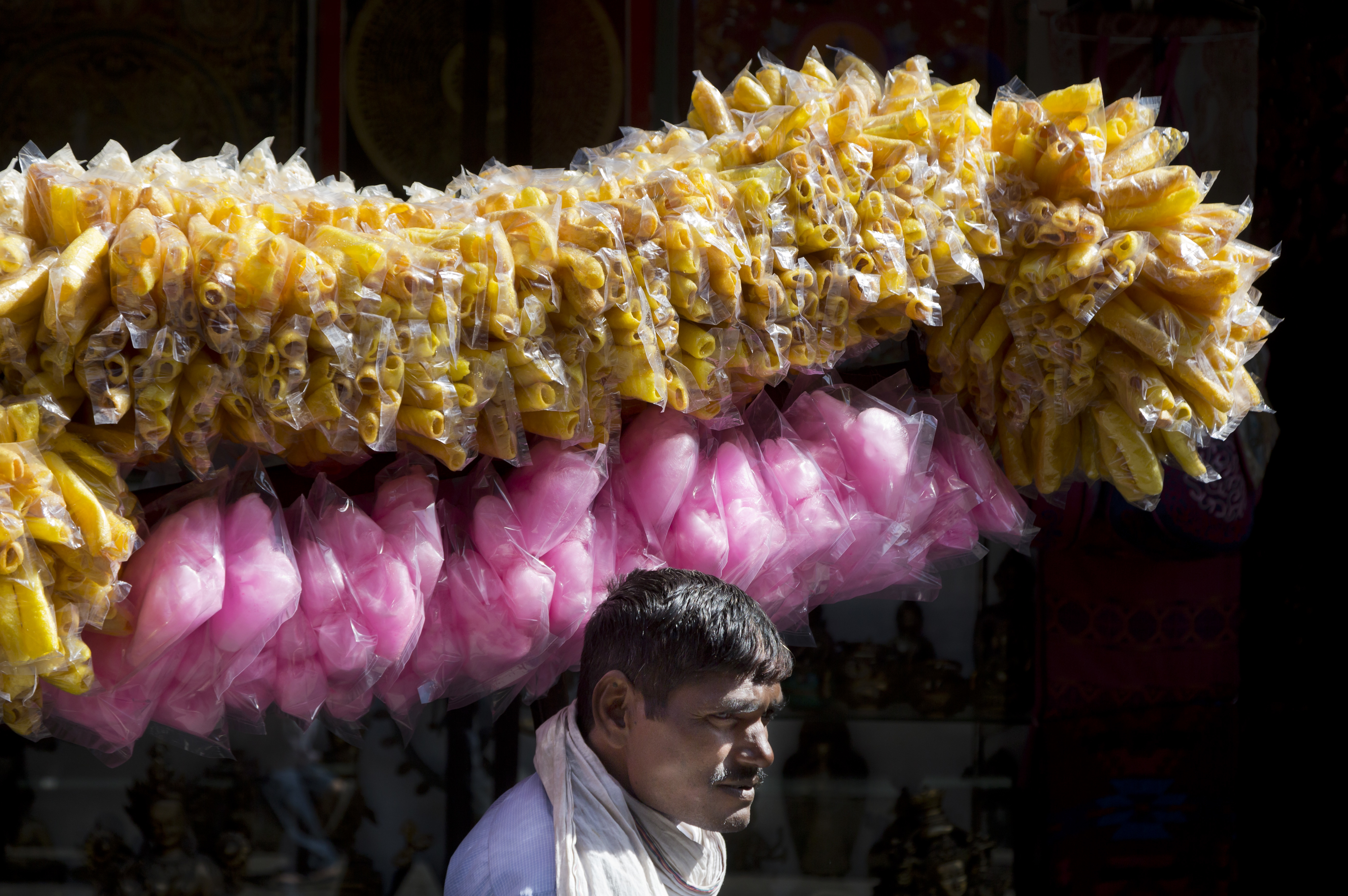 A vendor sells crips and candy floss in Dharmsala - AP