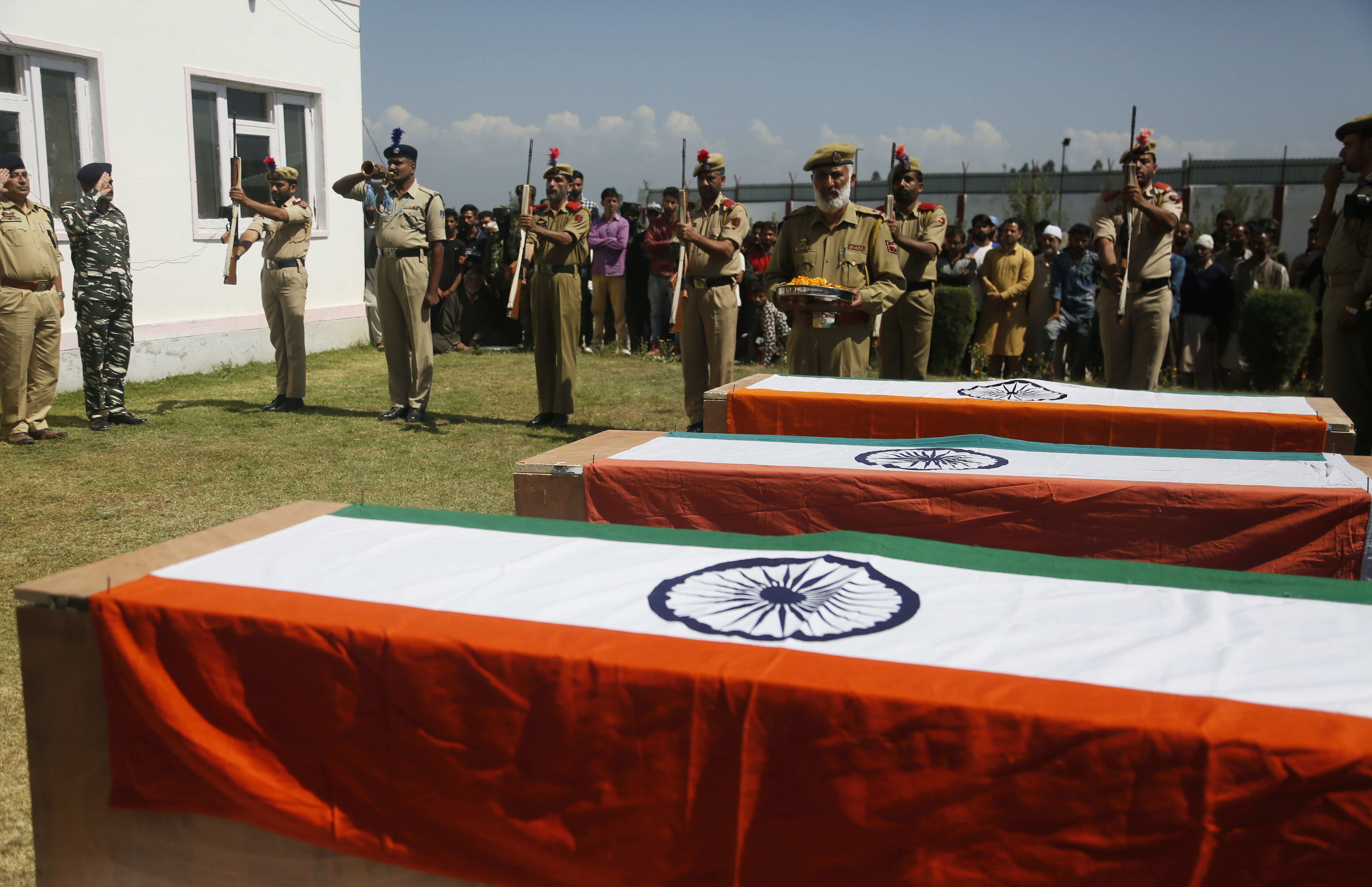 Indian police officers pays respects to colleagues who were killed by rebels, during a wreath laying ceremony at a base camp at shopian - AP