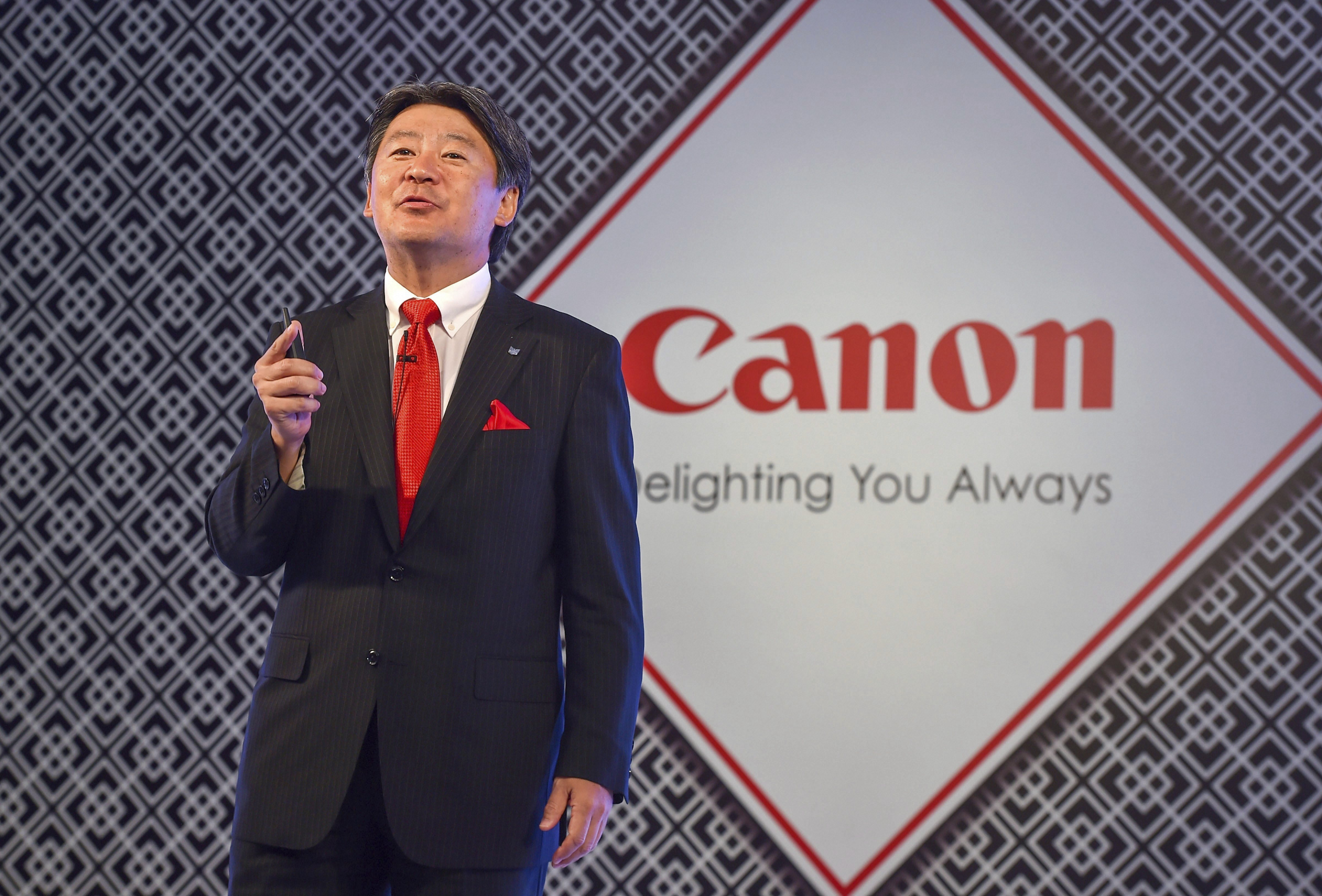 Vice President of Head of Imaging Communication Proucts Group (Canon China, Canon Asia Marketing Group) Toshiyuki (Tiger) Ishii during the launch of Canon's first full frame mirrorless digital camera and a new line up of lenses, at a press conference in New Delhi - PTI