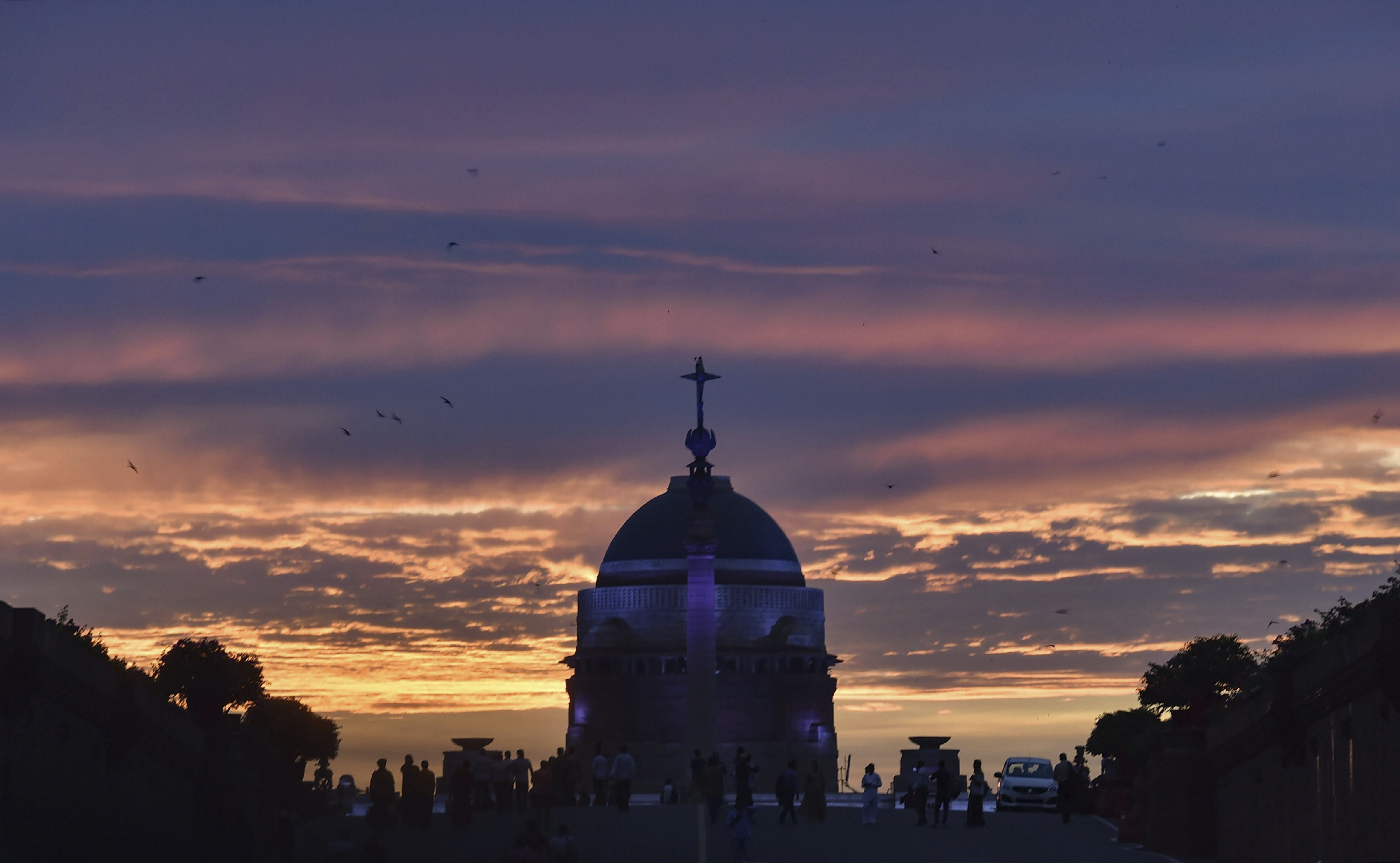 A view of the sunset over Raisina Hills, in New Delhi - PTI