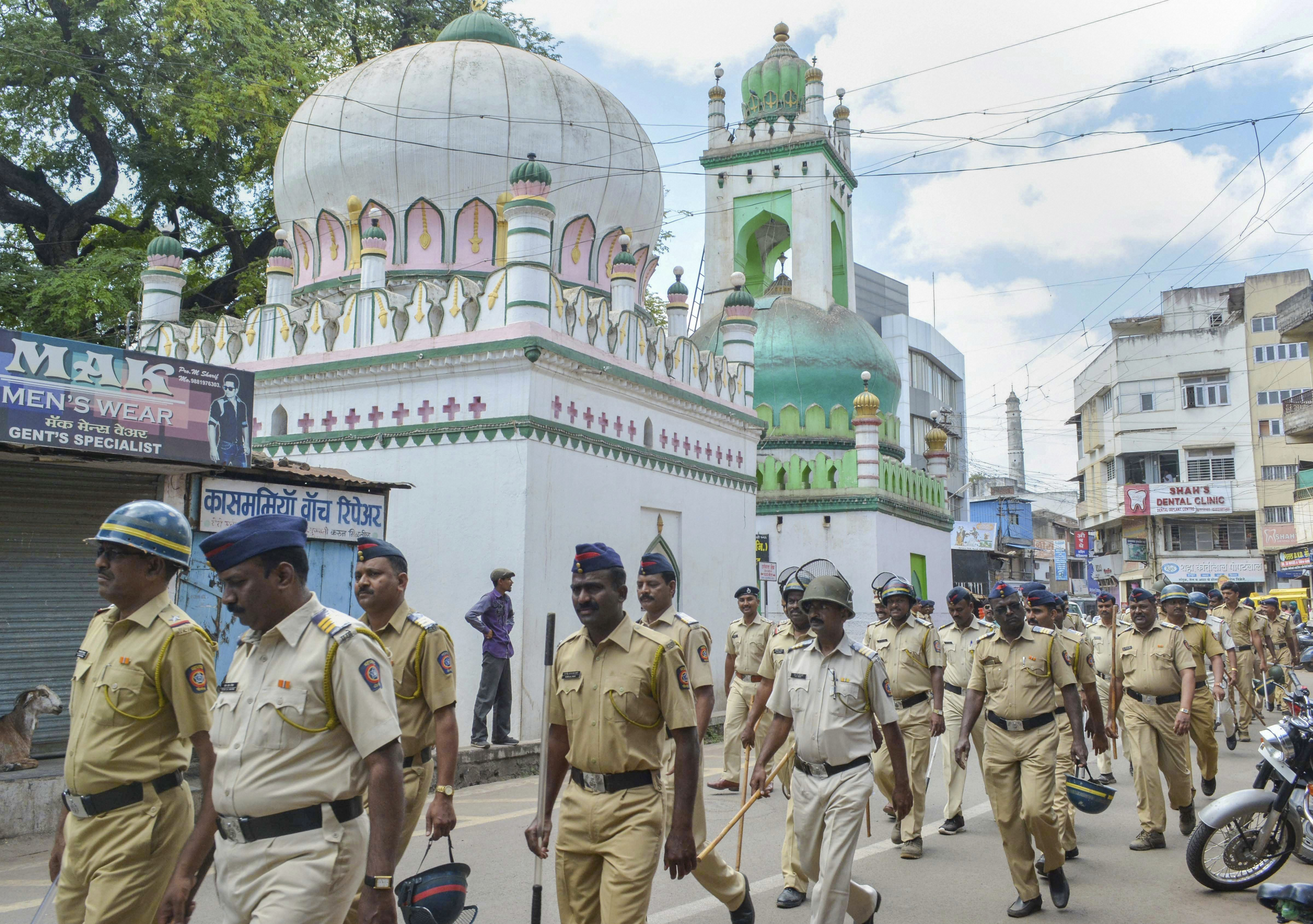 Police personnel conduct march in a sensitive locality, on the eve of Muharram in Karad, Maharashtra - PTI