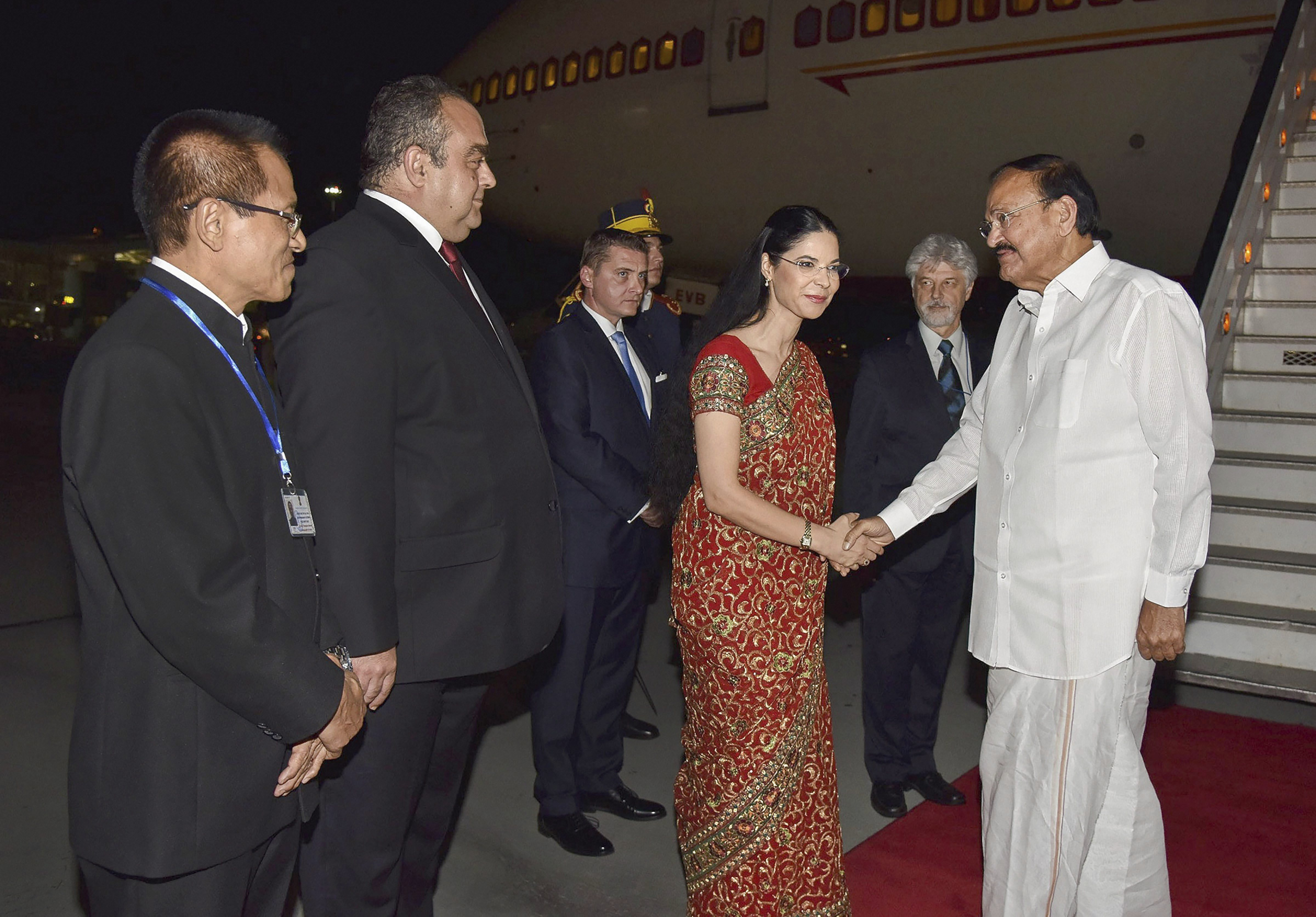 Vice President M Venkaiah Naidu (R) is greeted by Vice Prime Minister of Romania Ana Birchall on his arrival in Bucharest, Romania - PTI