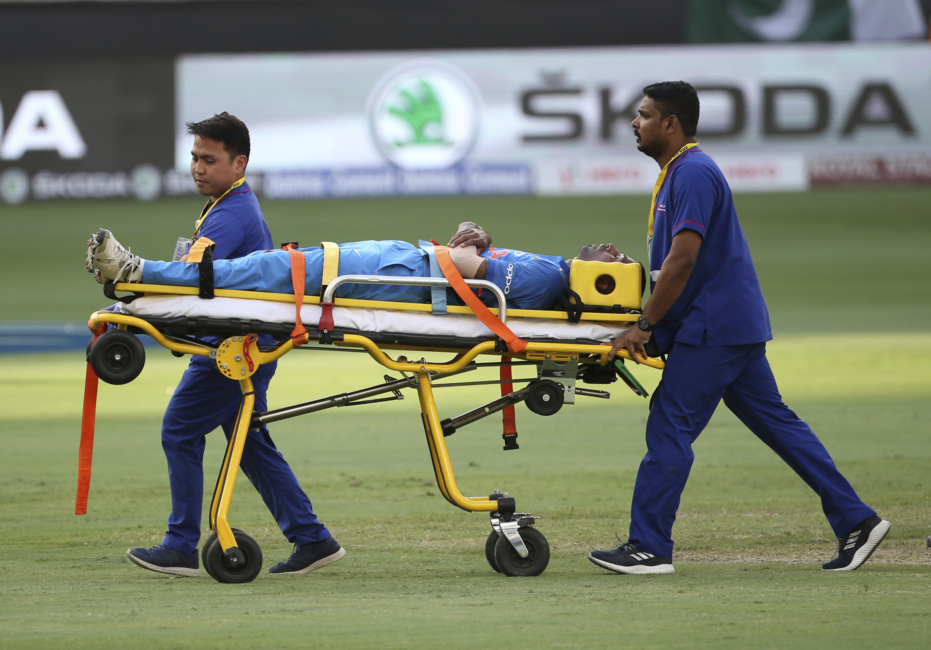 India's Hardik Pandya is taken out of the field on a stretcher after he fell after bowling a delivery during the one day international cricket match of Asia Cup between India and Pakistan in Dubai - AP