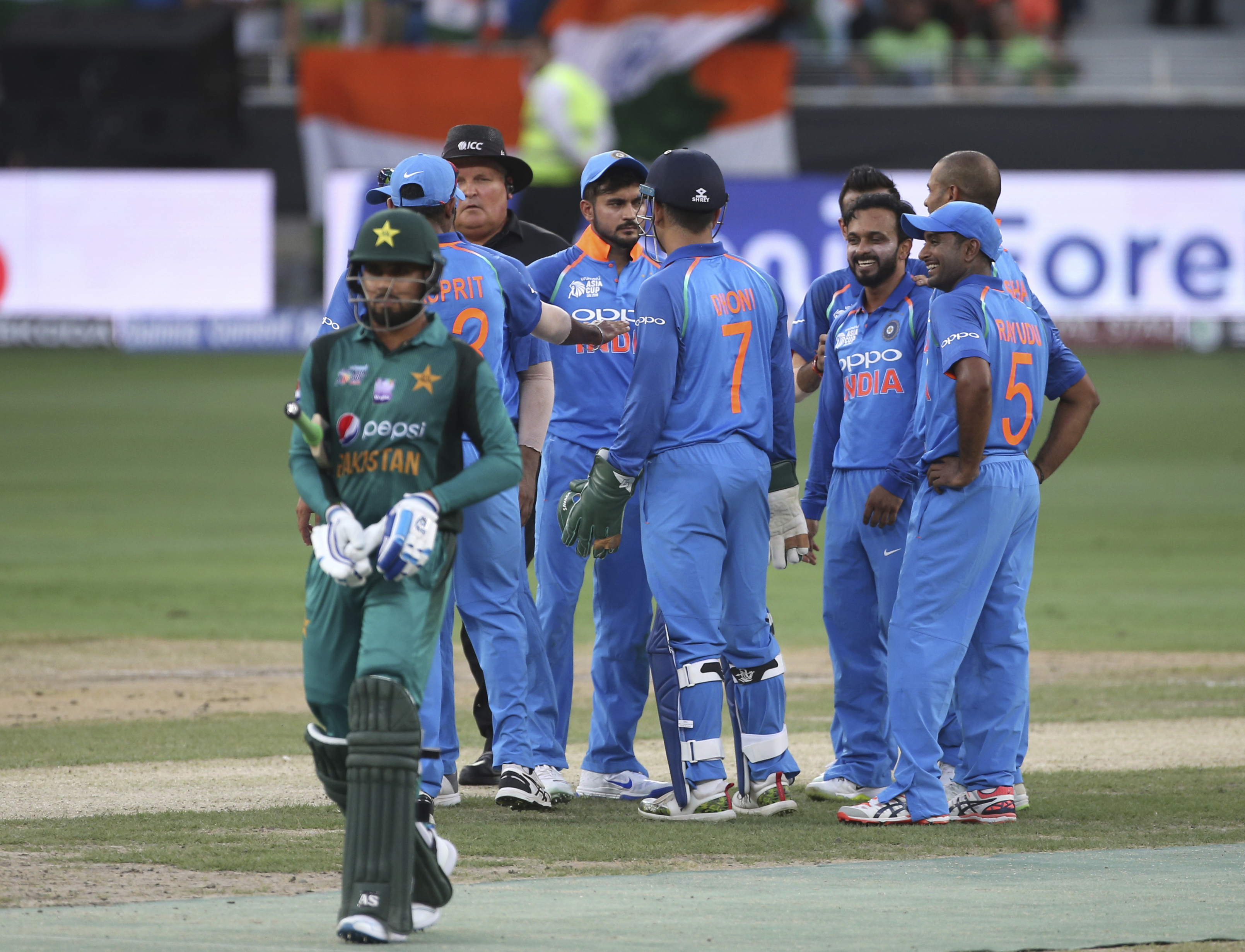India's Kedar Jadhav, third right, celebrates with teammates the dismissal of a Pakistan batsman during the one day international cricket match of Asia Cup between India and Pakistan in Dubai, United Arab Emirates - AP