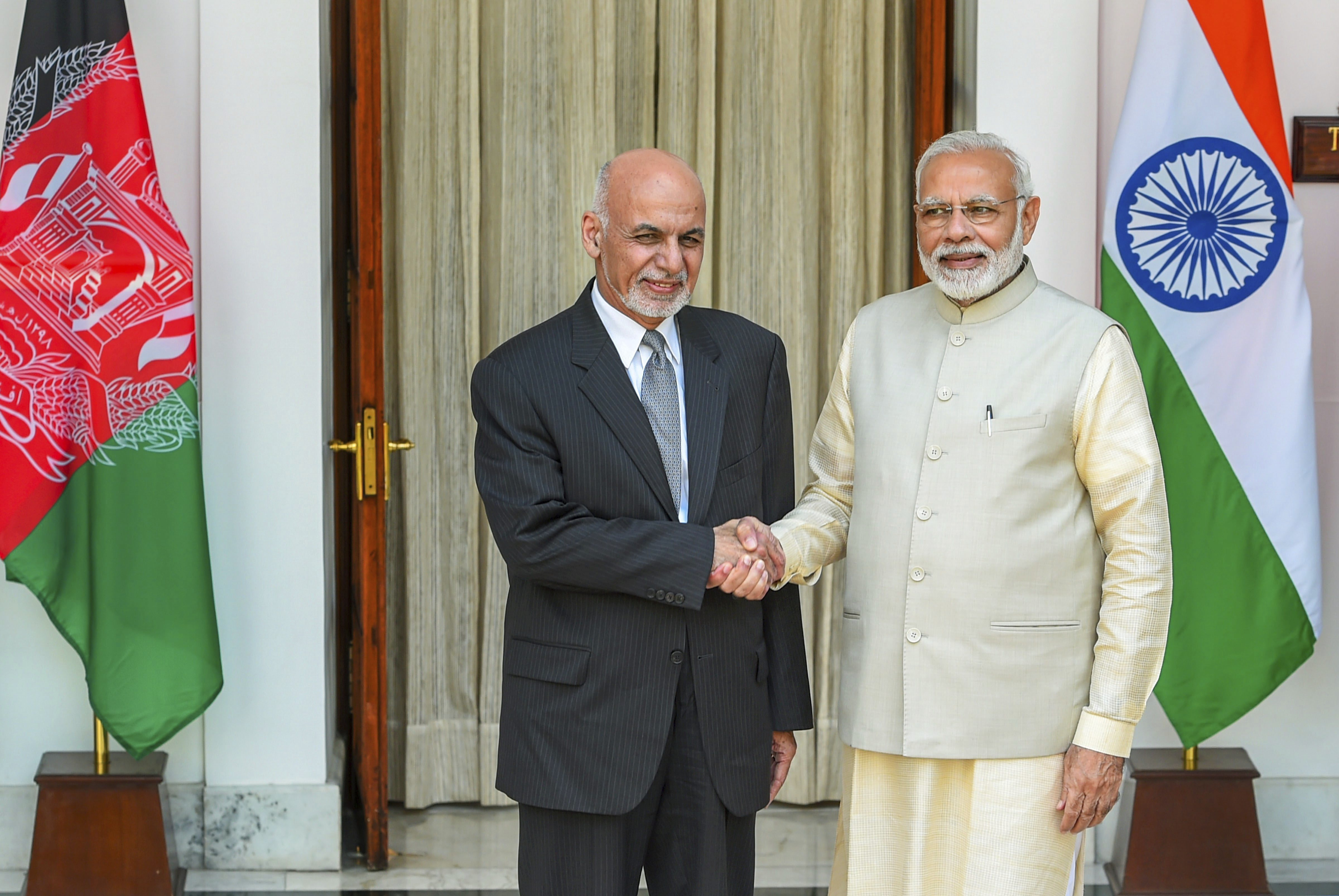 Prime Minister Narendra Modi (R) and Afghanistan President Ashraf Ghani ahead of a meeting at Hyderabad House, in New Delhi - PTI