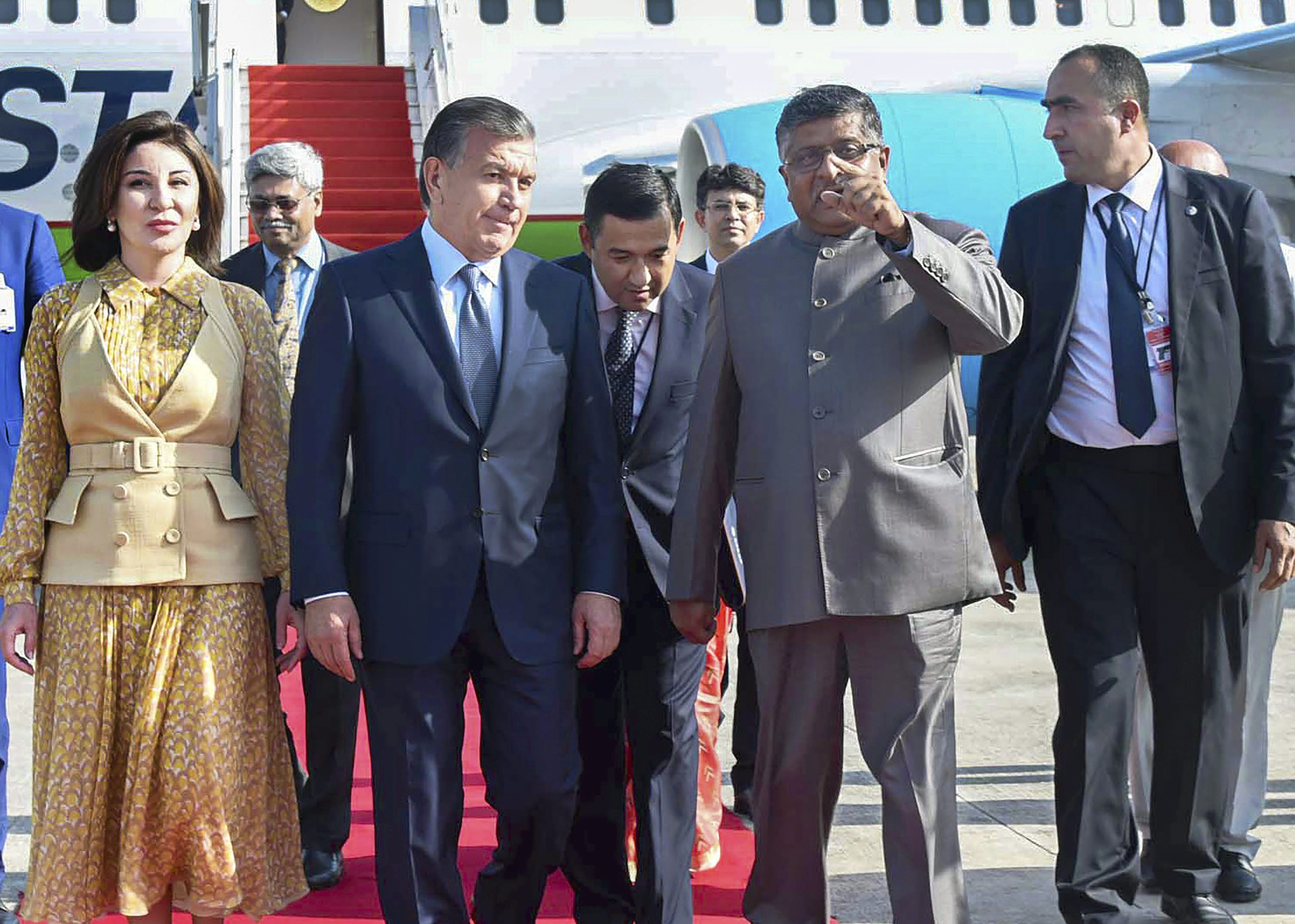 President of the Republic of Uzbekistan Shavkat Mirziyoyev being received by the Union Minister for Electronics & Information Technology and Law & Justice Ravi Shankar Prasad, in New Delhi - PTI