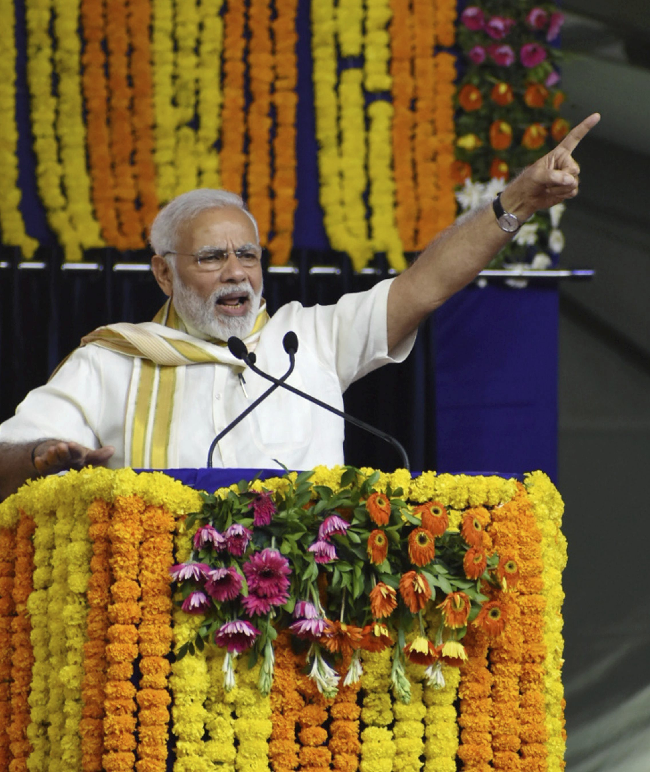 Prime Minister Narendra Modi addresses a public meeting at the inauguration of Mahatma Gandhi Museum and several other development projects,in Rajkot - PTI