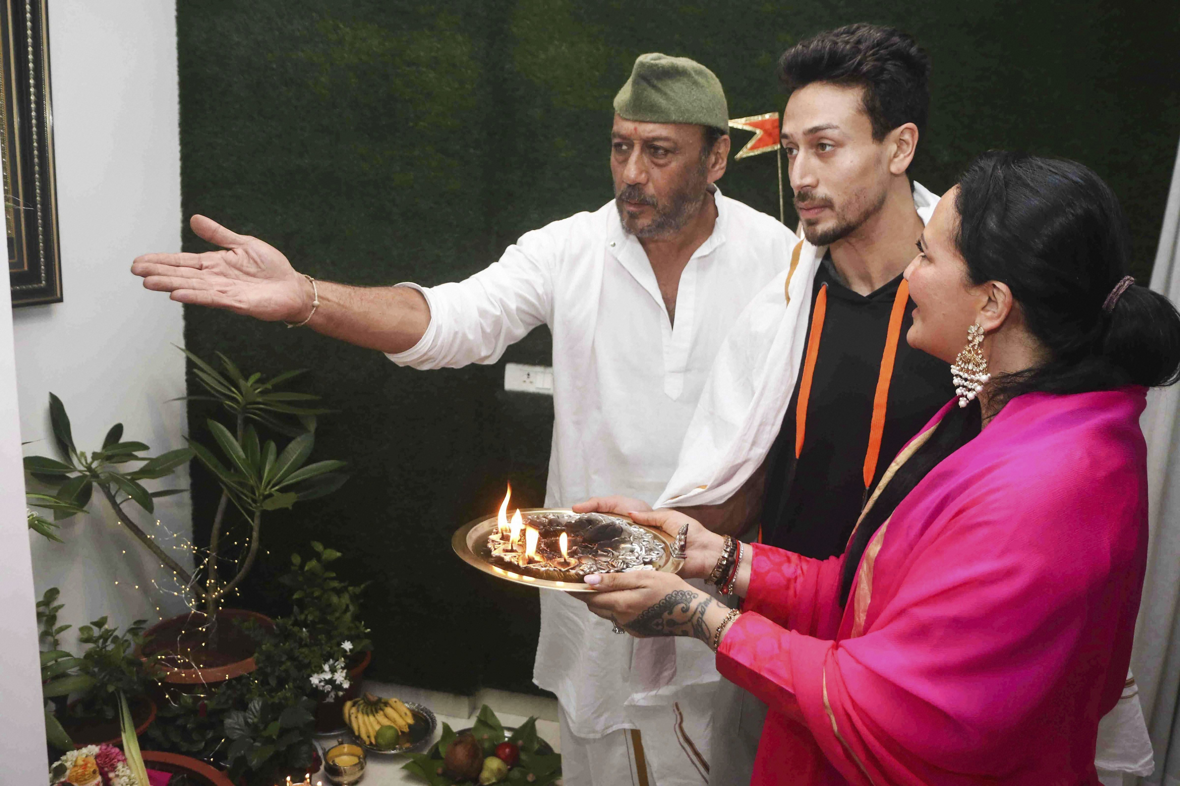 Bollywood actor Jackie Shroff with wife Ayesha Shroff and son Tiger Shroff offer prayers on the occasion of Ganesh Chaturthi festival, in Mumbai - PTI