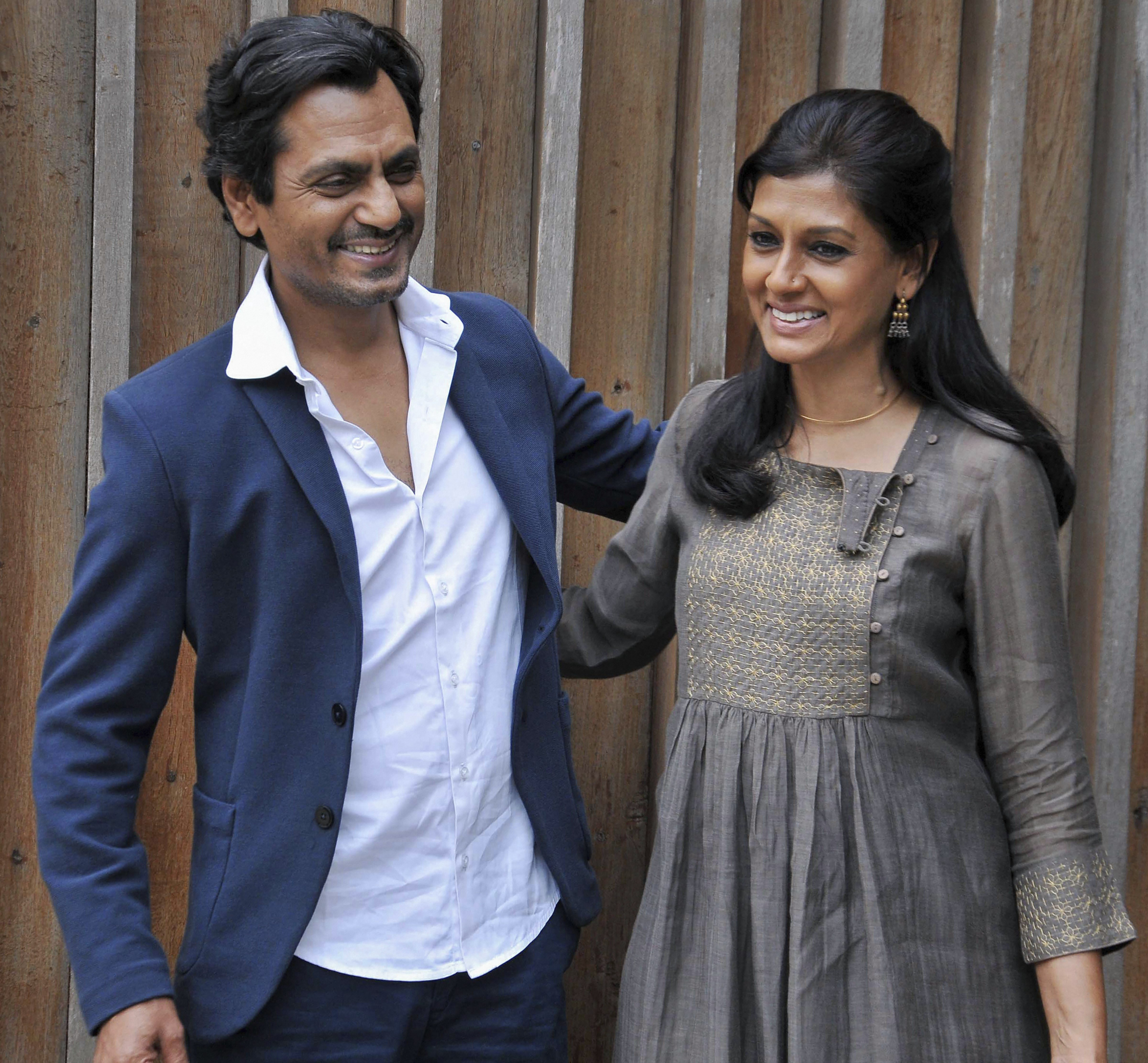 Bollywood actor Nawazuddin Siddiqui speaks as actress and film director Nandita Das on during the promotion of their upcoming movie 'Manto', in Kolkata - PTI