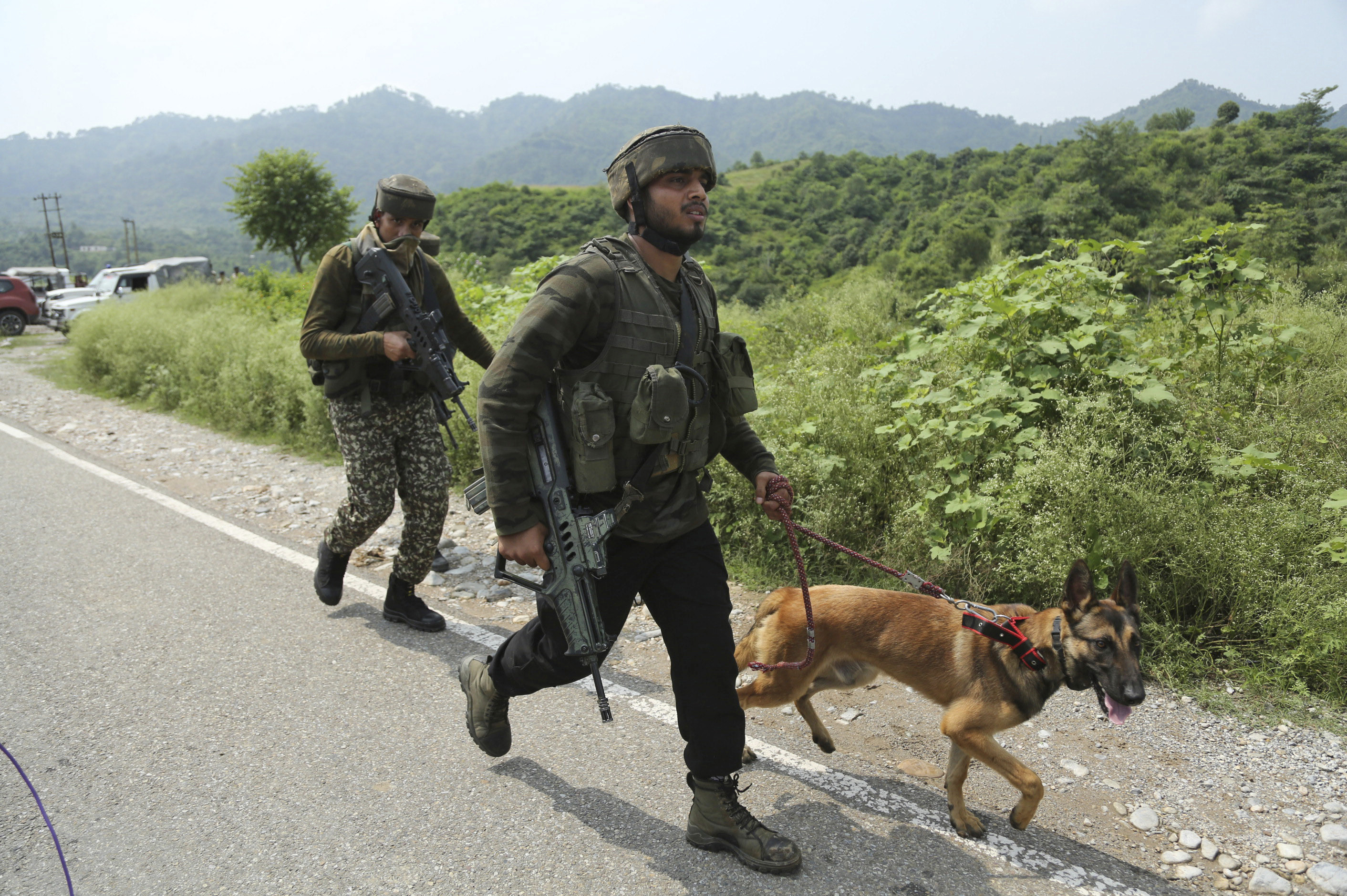 Indian army soldiers arrive at the site of a gun battle with suspected militants at Kakriyal village, in Jhajjar Kotli, 35 kilometers from Jammu
