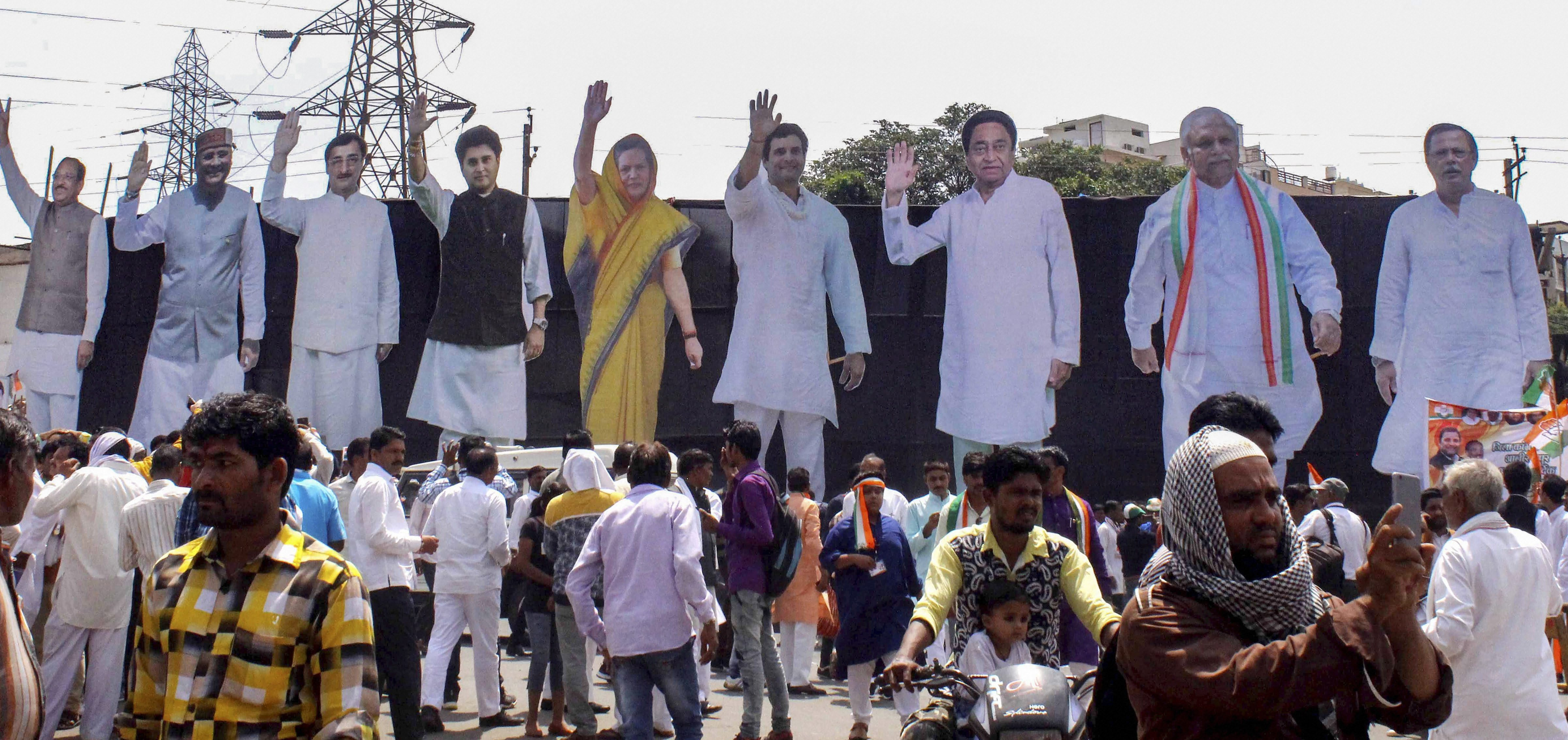 Larger than life cut-outs of Congress party leaders displayed during Congress President Rahul Gandhi's roadshow, in Bhopal - PTI