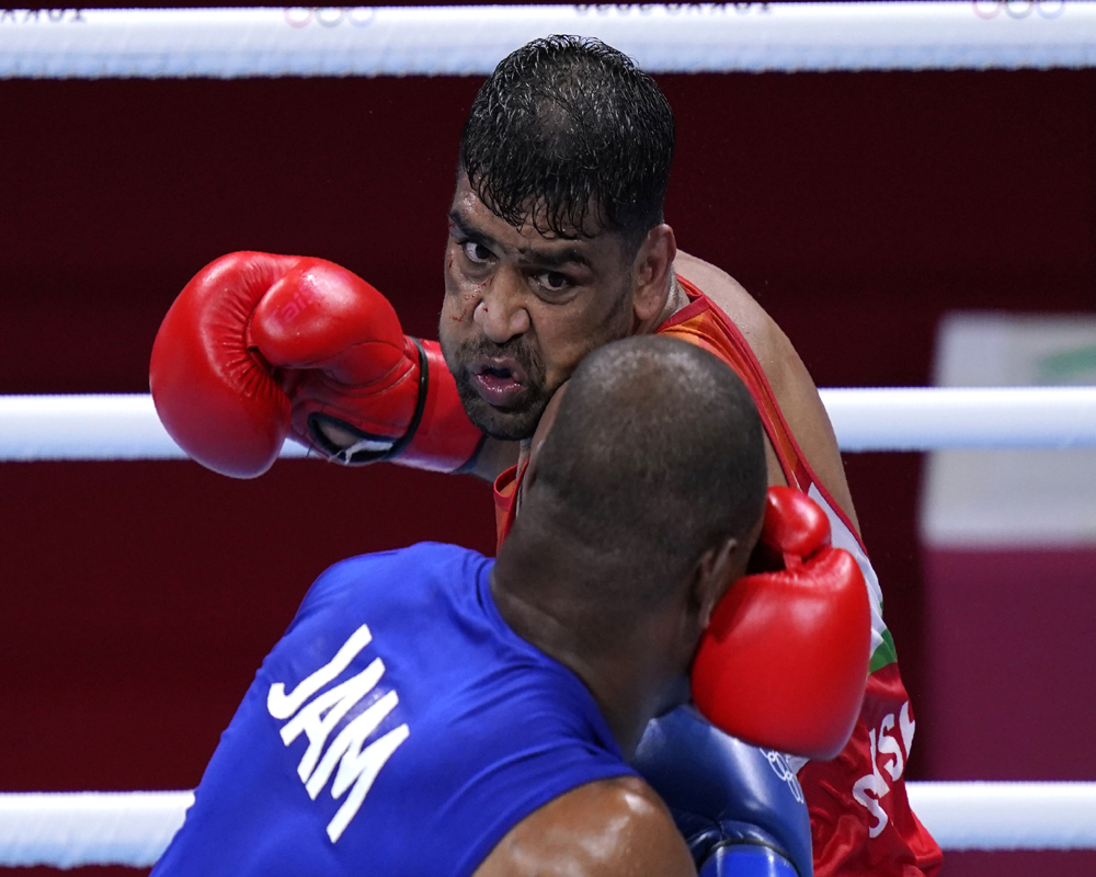 Tokyo: Satish Kumar, top, of India exchanges punches with Ricardo Brown of Jamaica during their men's super-heavy weight 91 kg preliminaries round Boxing match at the 2020 Summer Olympics