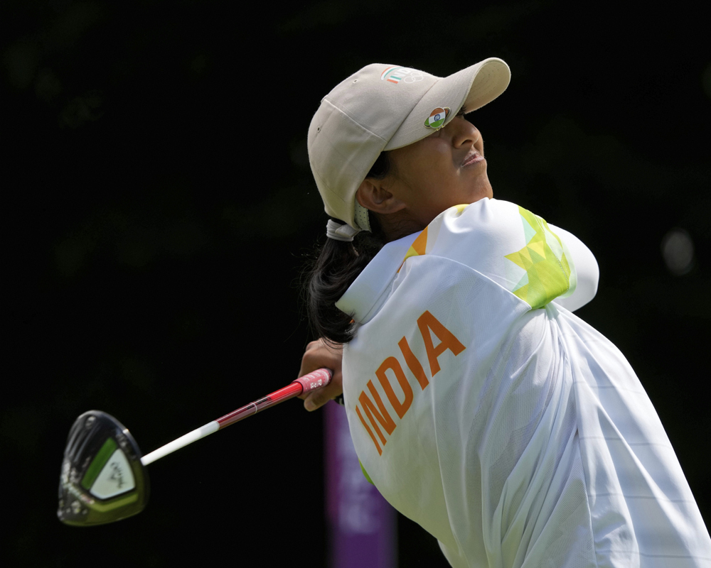 Aditi Ashok, of India, watches her tee shot on the second hole during the final round of the women's golf event at the 2020 Summer Olympics