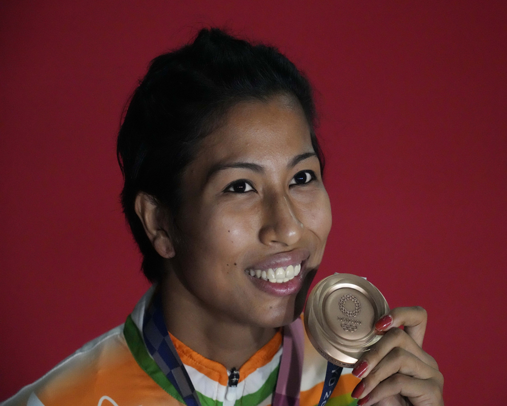 Bronze medalist India's Lovlina Borgohain holds her medal after the ceremony for their women's welter weight 64-69kg competition at the 2020 Summer Olympics