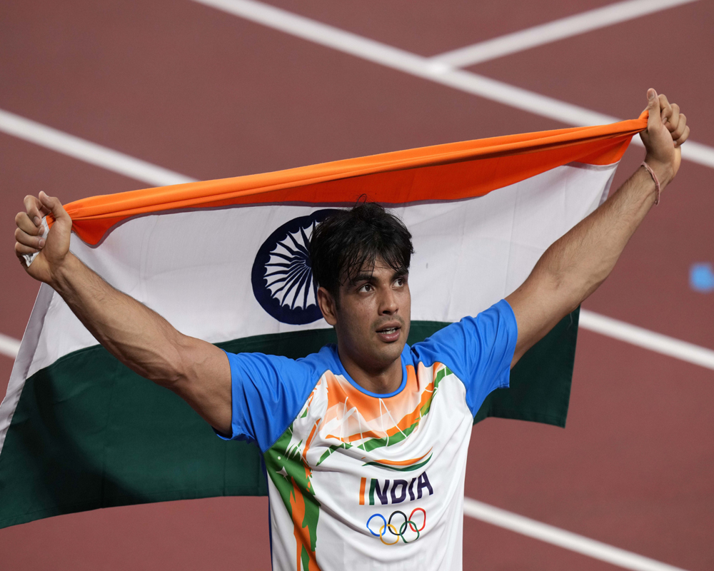 Neeraj Chopra, of India celebrates winning the gold medal in the final of the men's javelin throw at the 2020 Summer Olympics