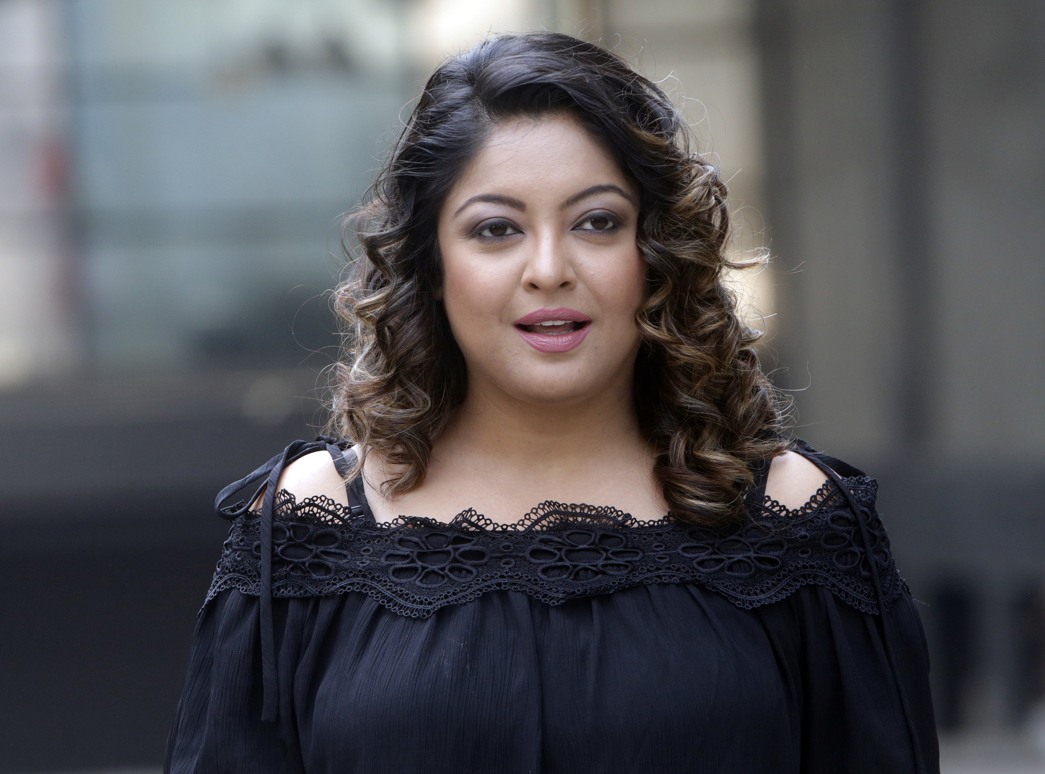 Former Bollywood actress Tanushree Dutta stands for photographs outside a media house in Mumbai - AP