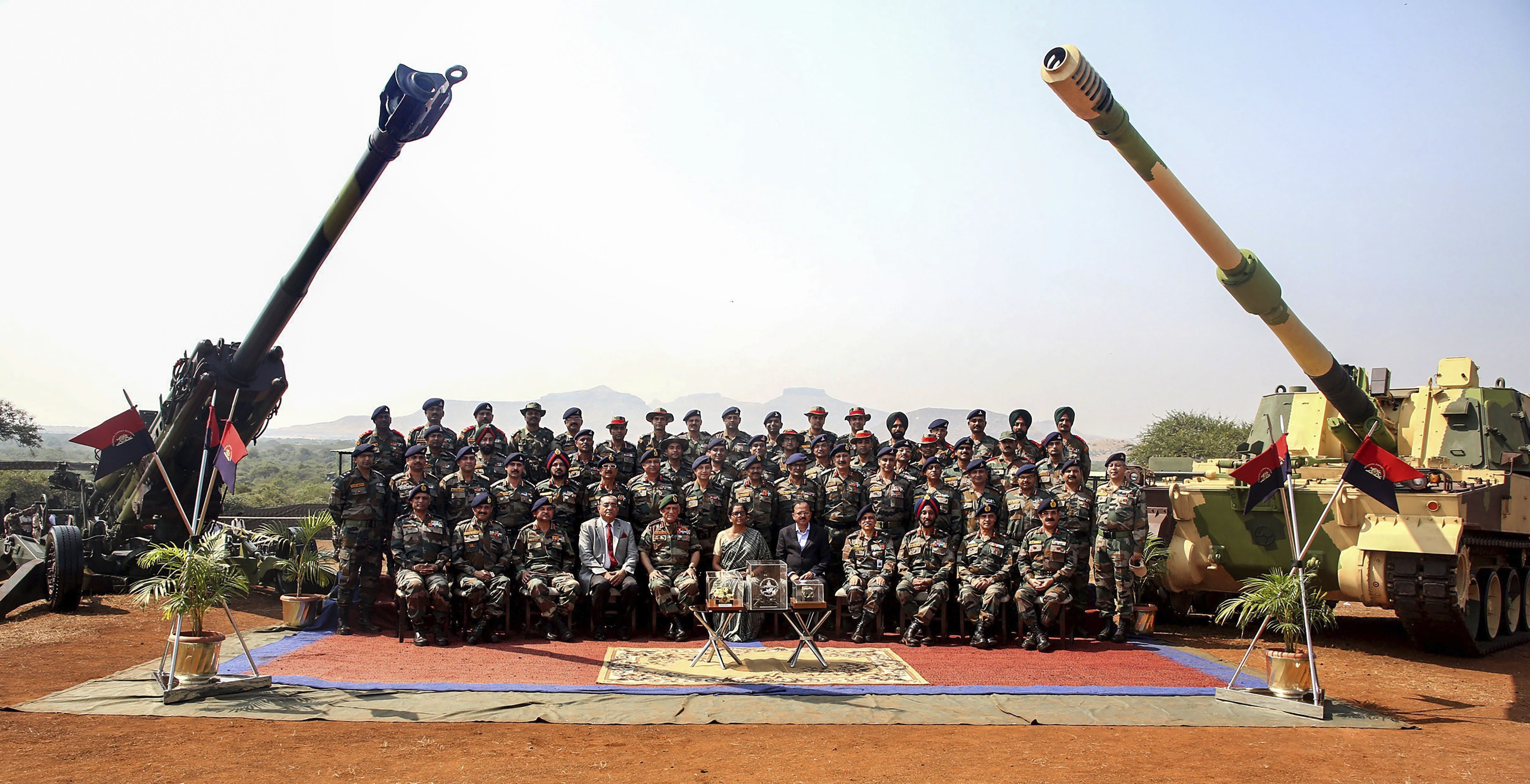 Defence Minister Nirmala Sitharaman, Army Chief General Bipin Rawat and others pose for a group photograph at the formal induction of three major artillery gun systems, including the M777 American Ultra Light Howitzers and the K-9 Vajra, into the Army during a ceremony at Deolali artillery centre, in Nashik district - PTI