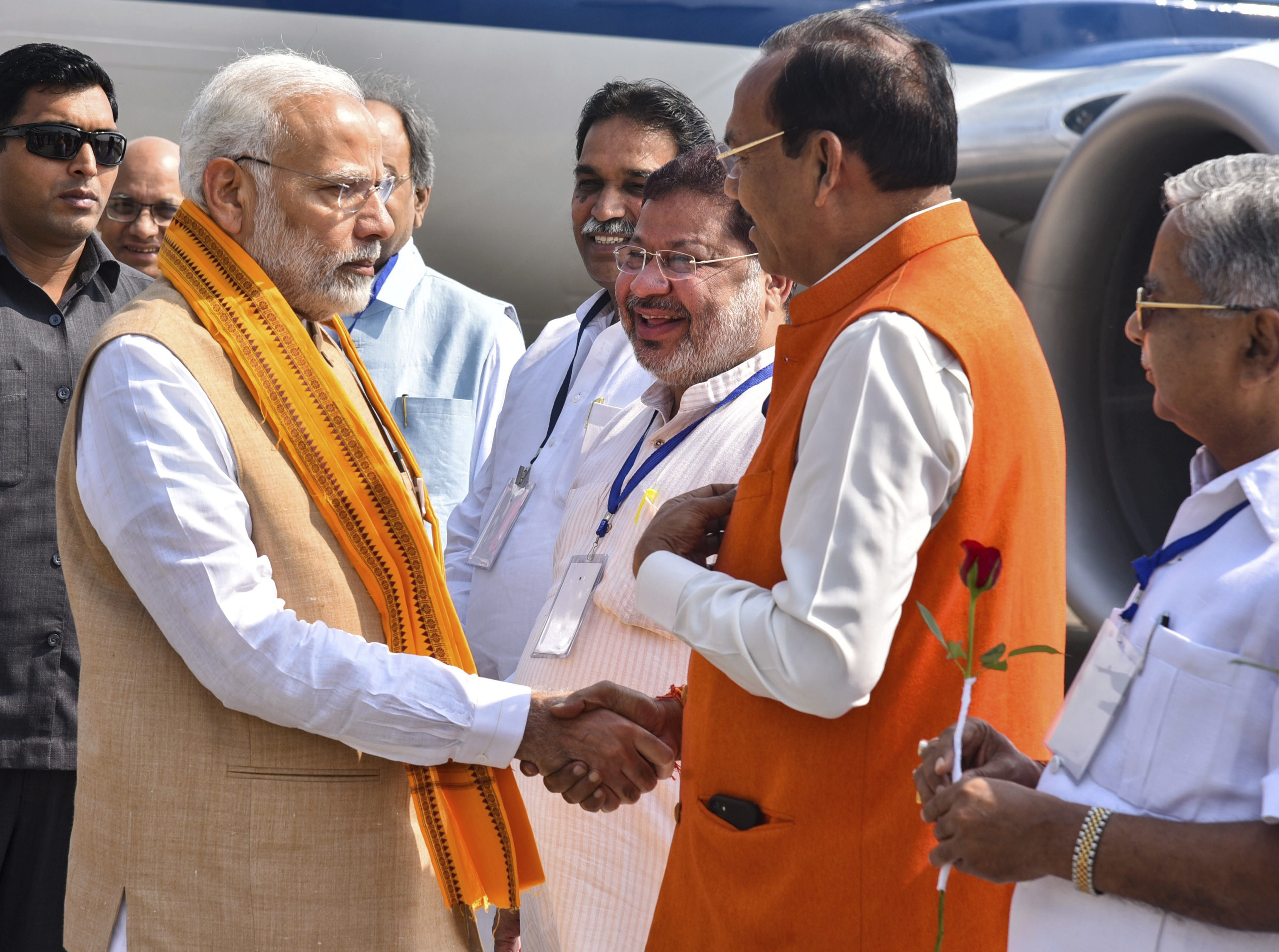 Prime Minister Narendra Modi is welcomed by the BJP leaders as he arrives at the Airport to attend an election rally at Jagdalpur, in Raipur - PTI