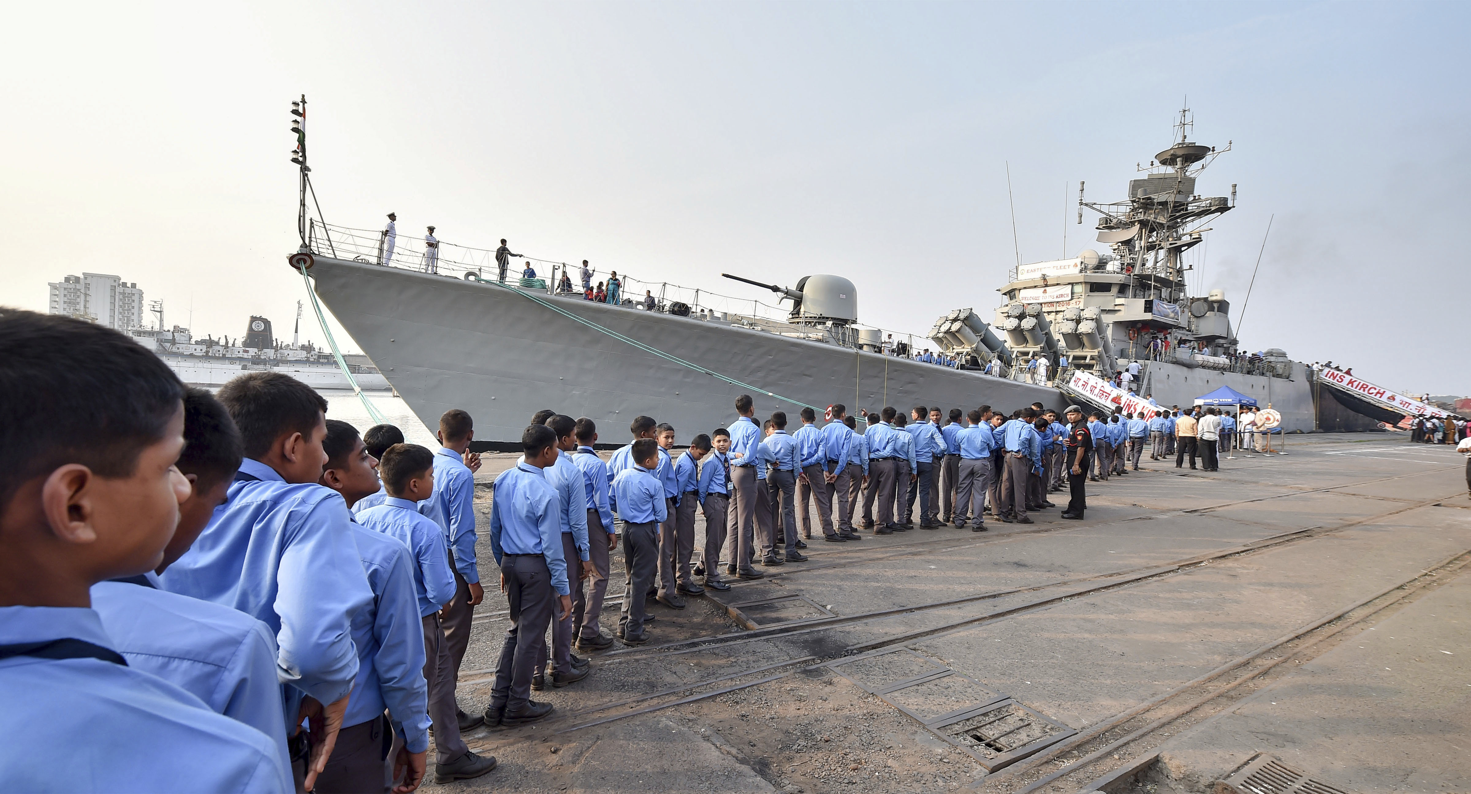 School students stand in a queue to board 'INS Kirch', a Navy warship from the eastern fleet, for a brief trip as part of Navy Week 2018 celebration, in Kolkata - PTI