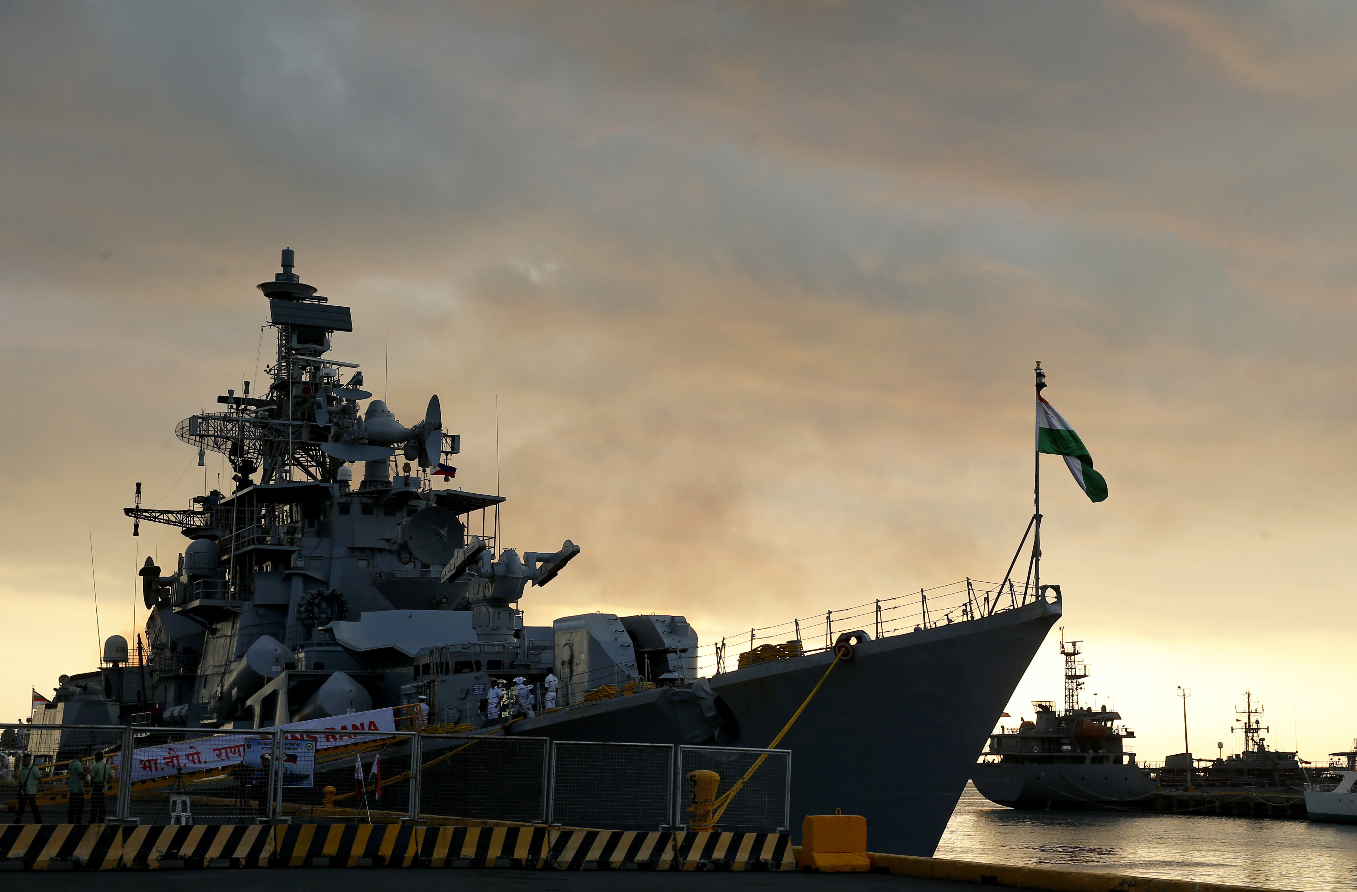 Indian Naval Ship INS Rana, a destroyer prepares to dock at Manila's South Harbor for a four-day port call at sunset Tuesday, Oct. 23, 2018 in Manila, Philippines - AP