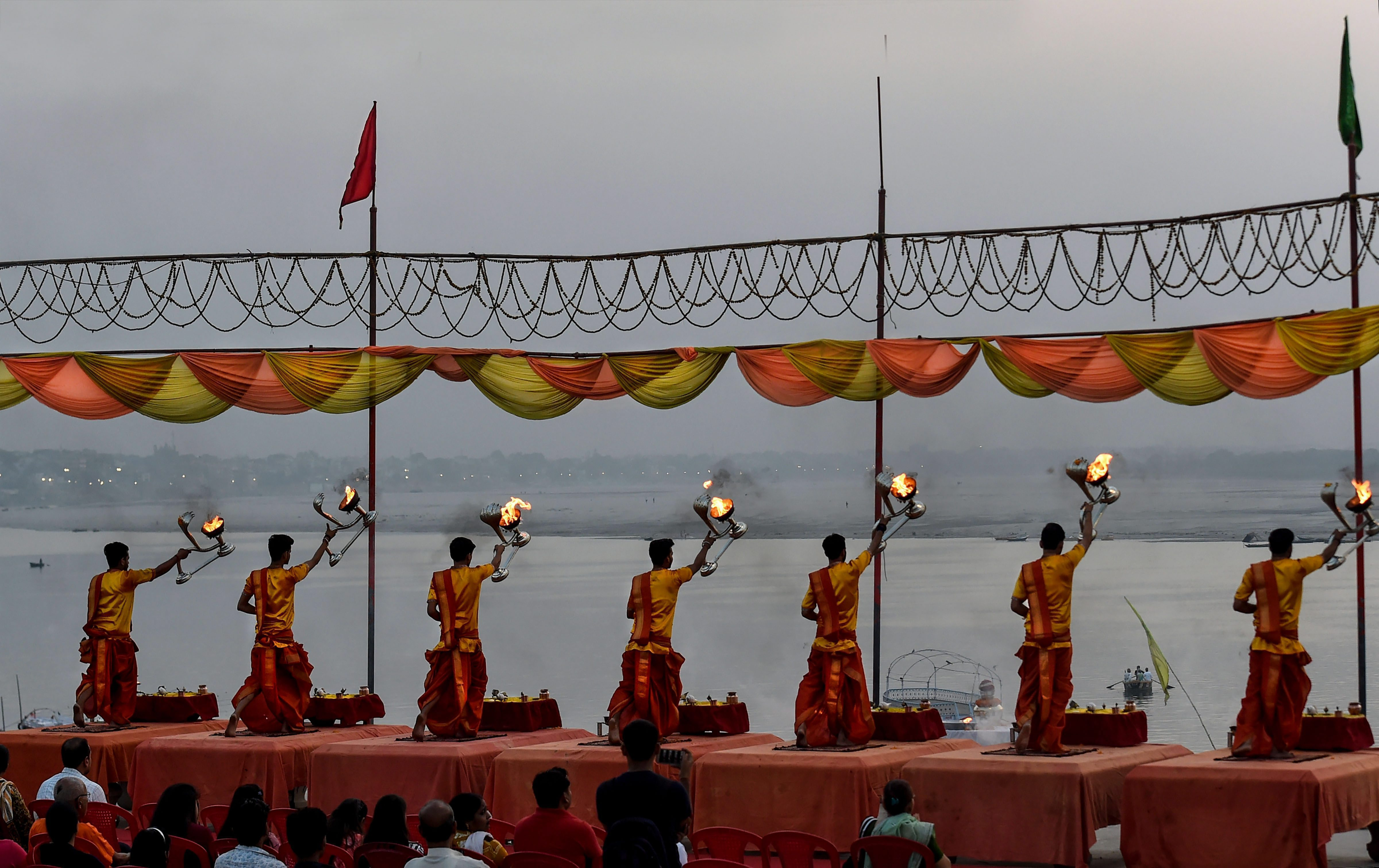 Temple priests perform 'Ganga Aarti' during dawn at Assi ghat, in Varanasi - PTI
