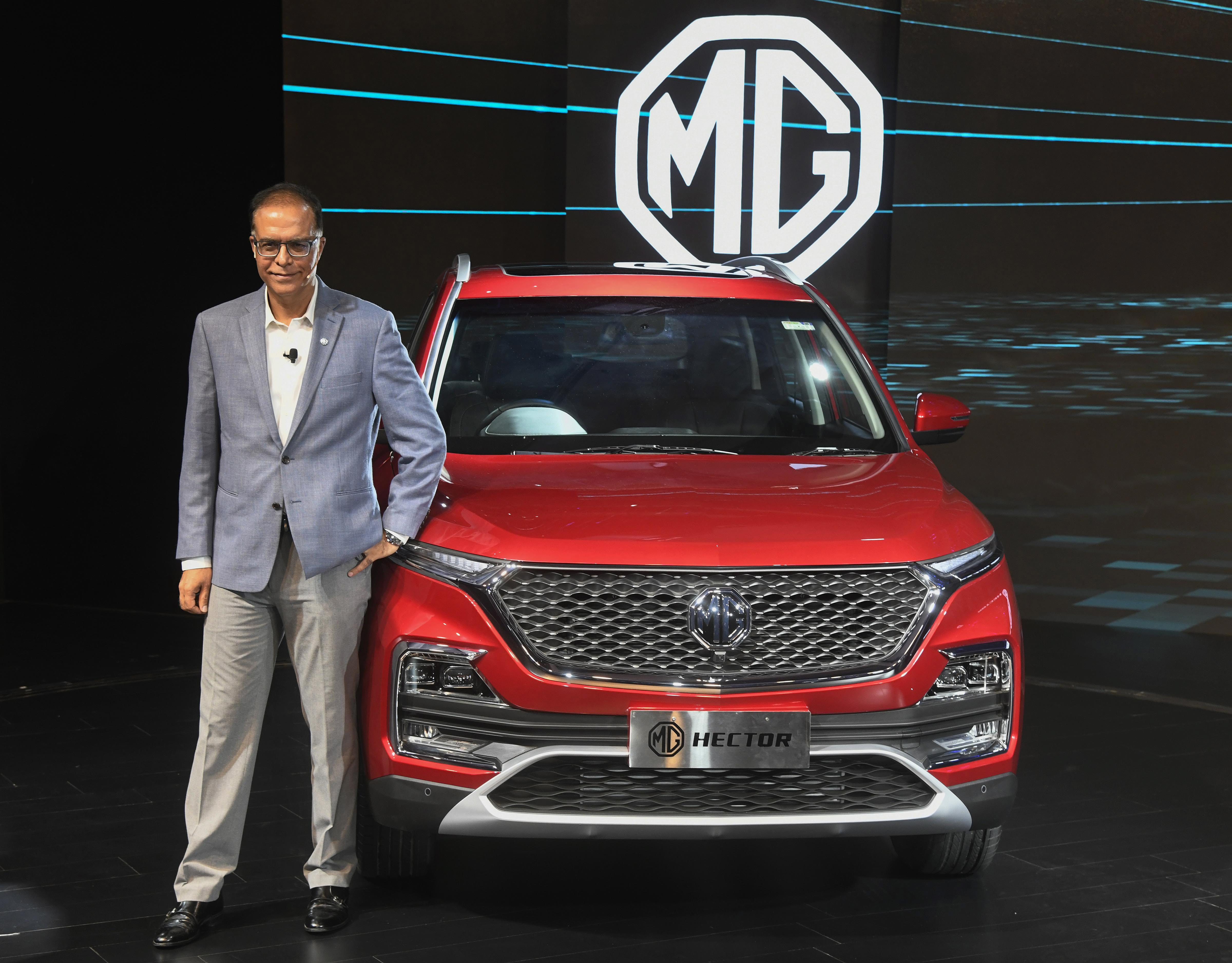 MG (Morris Garages) India President and Managing Director Rajeev Chaba poses next to company's Hector SUV during its launch, in Mumbai - PTI