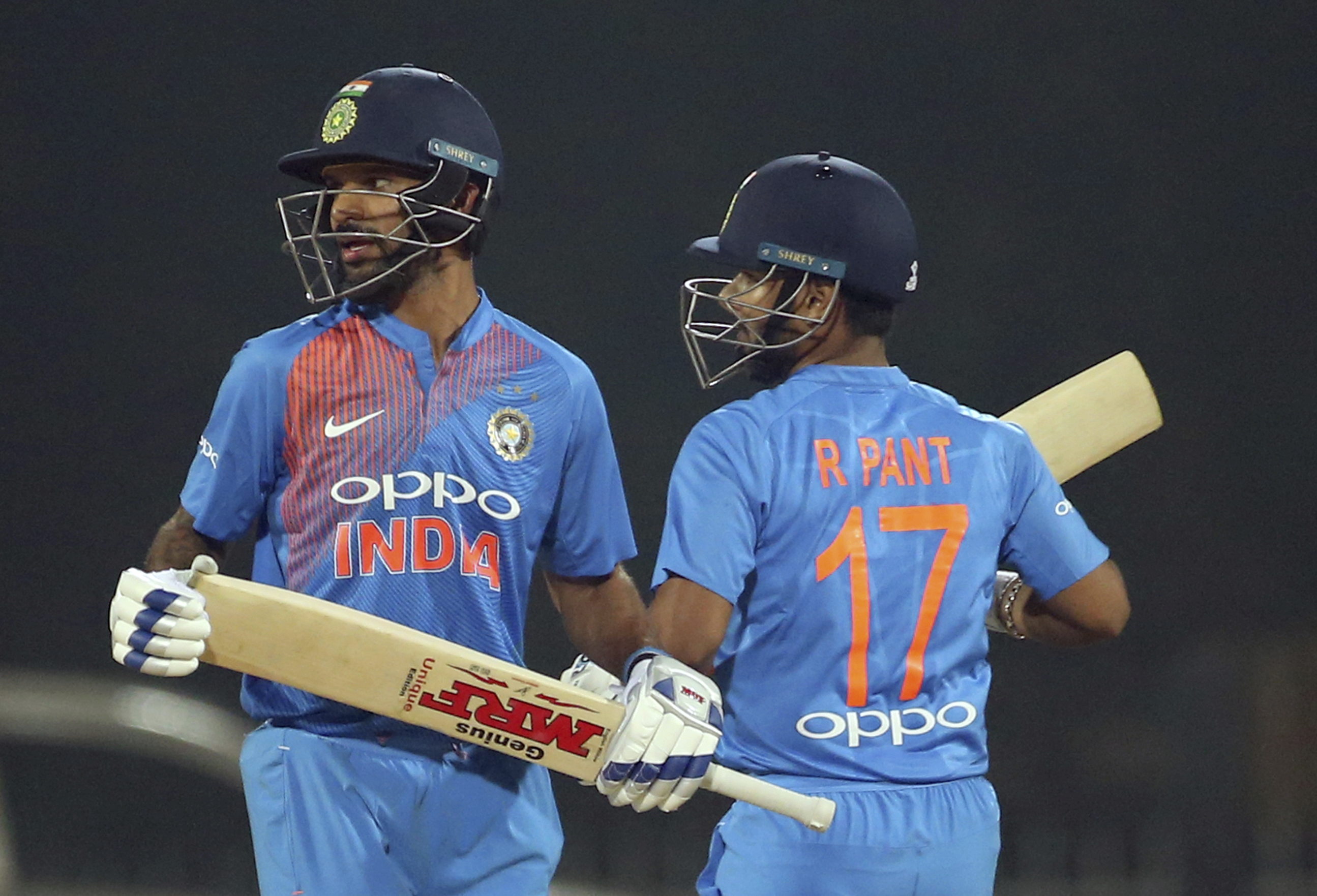 India's Shikhar Dhawan, left, and Rishabh Pant run between the wickets during the third and last Twenty20 international cricket match between India and West Indies in Chennai - AP