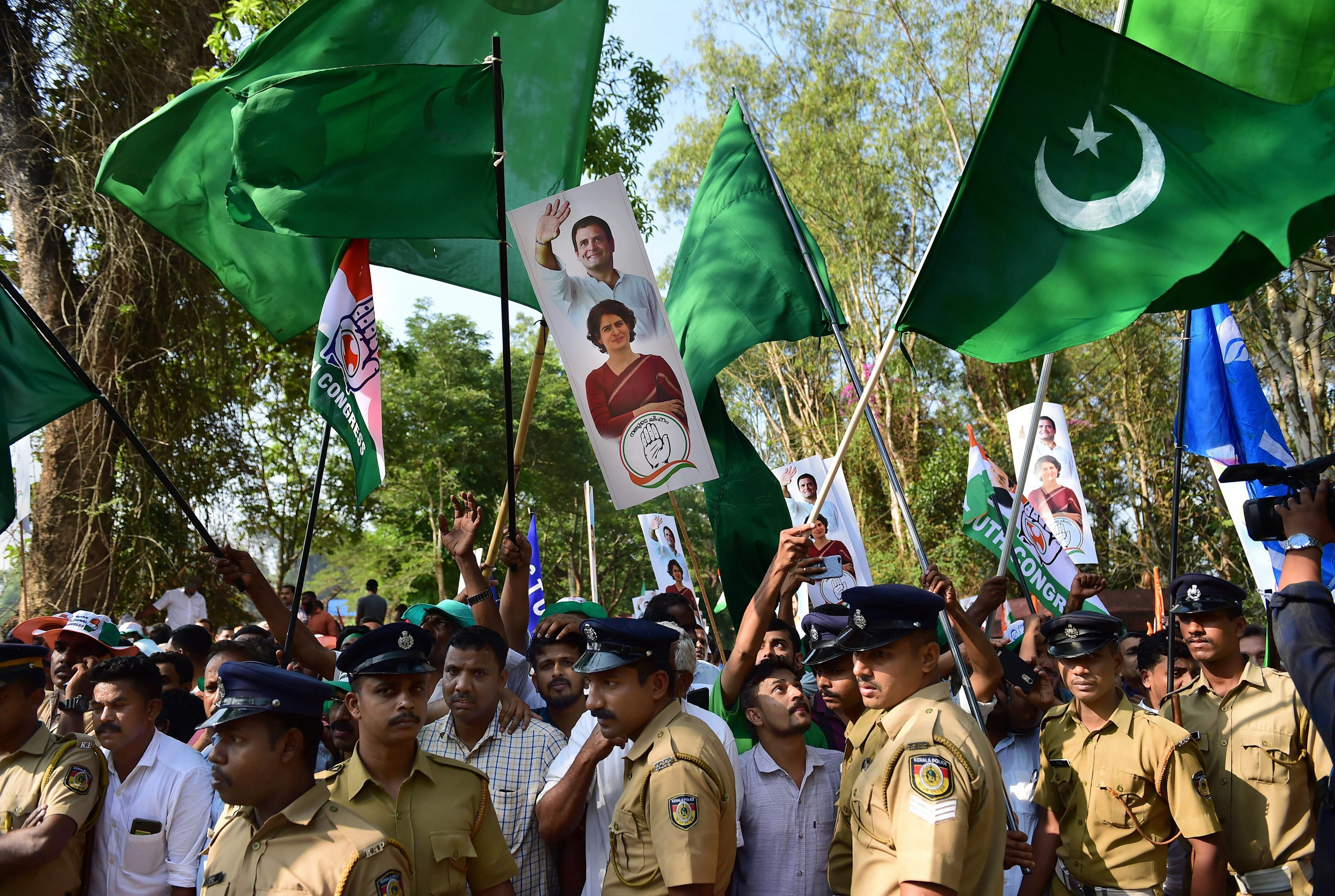 Indian Union Muslim League (IUML) supporters, with green flags, join supporters of Congress as they wave flags prior to the filing of nomination papers by Congress President Rahul Gandhi, in Wayanad - PTI