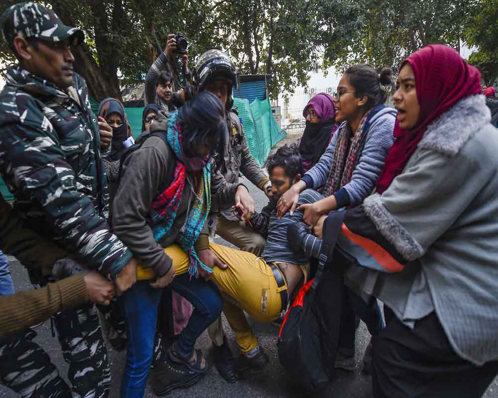 Police personnel detain a protestor taking part in a march demanding for the release of Bhim Army leader Chandrasekhar Azad and against the amended Citizenship Act, NRC and NPR, in New Delhi - PTI