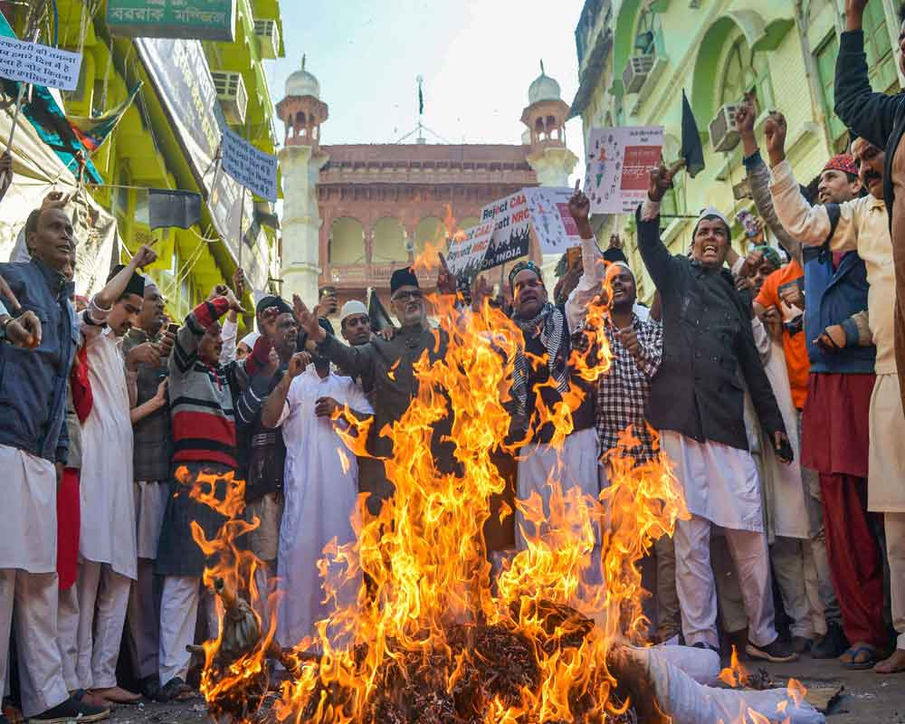 Protestors raise slogans during a demonstration against CAA and NRC after Friday prayers, in Ajmer - PTI