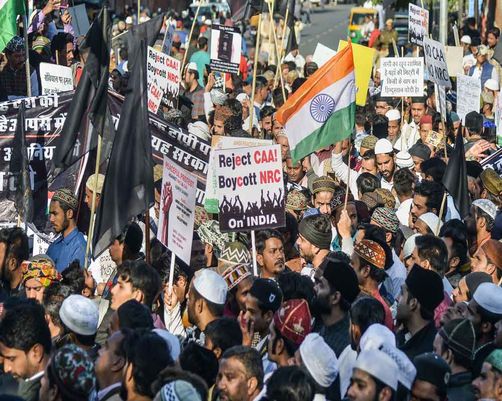 Protestors shout slogans and display placards during a demonstration against the amended Citizenship Act in Ajmer - PTI