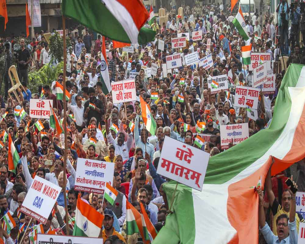 People take part in a rally in support of Citizenship (Amendment) Act, led by former Maharashtra CM Devendra Fadnavis, in Mumbai - PTI