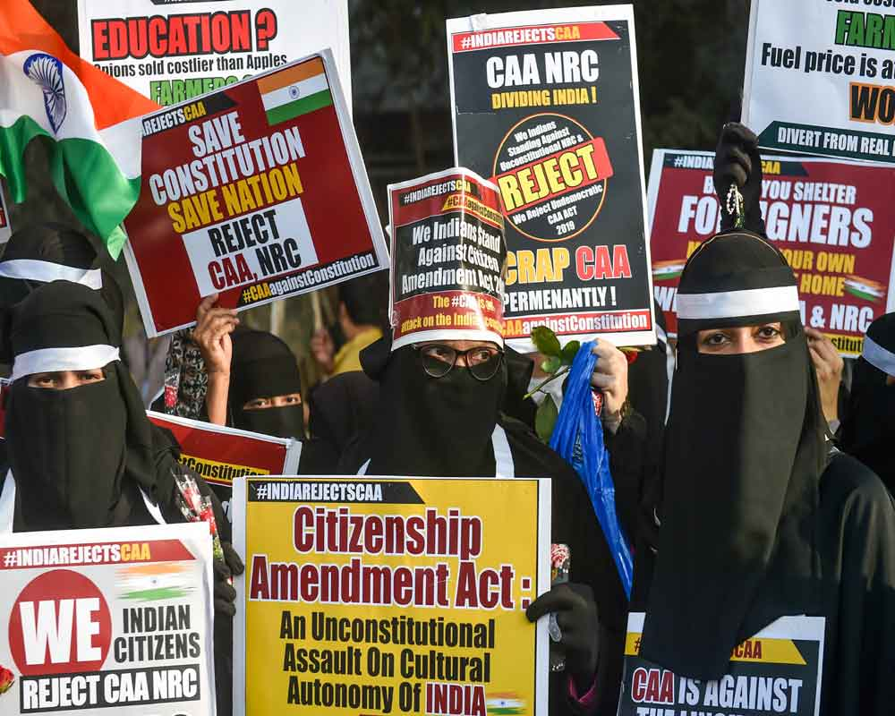 Protesters participate in a rally to oppose CAA and NRC, organised by Joint Action Committee for Social Justice, at Azad Maidan in Mumbai - PTI