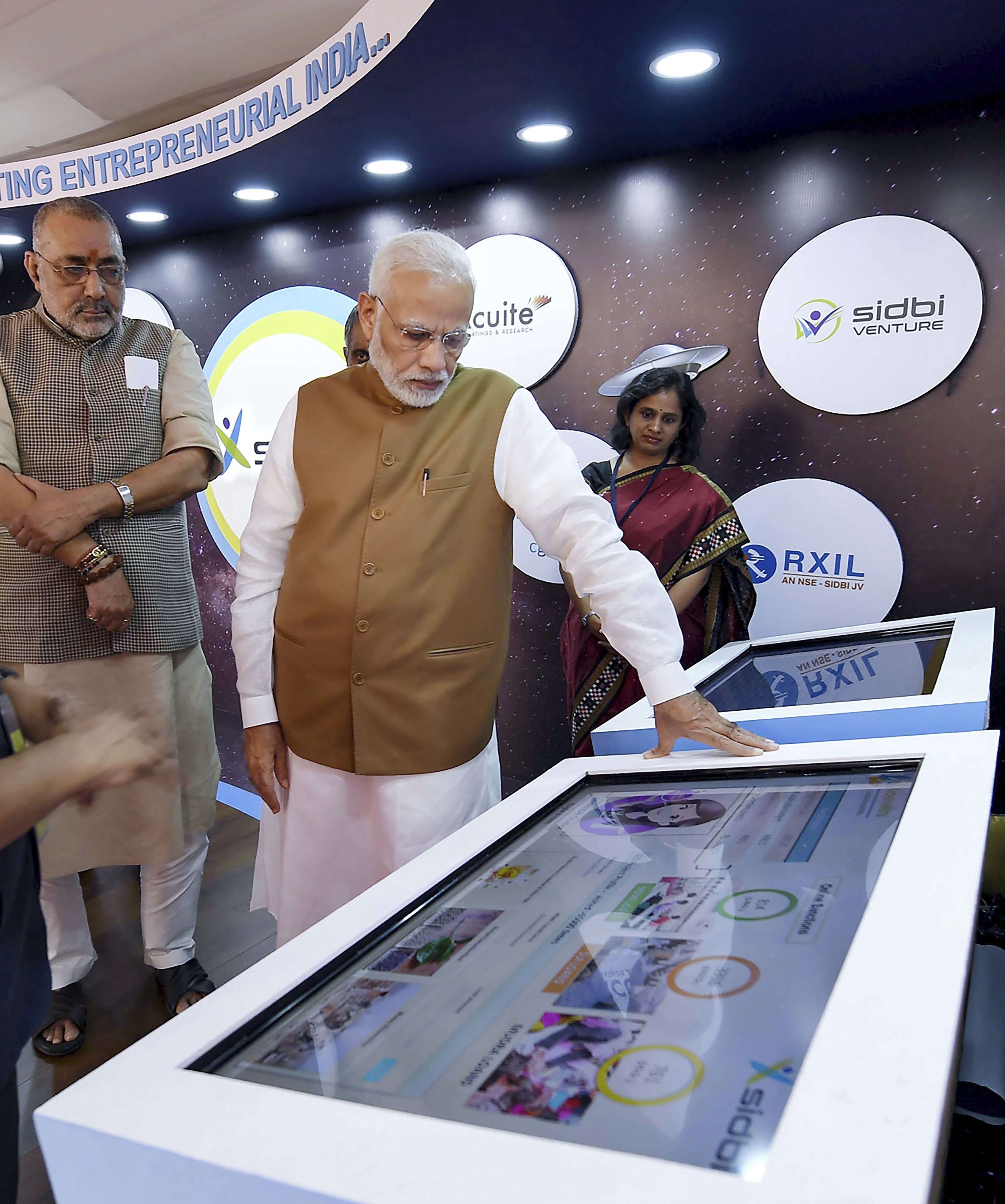Prime Minister Narendra Modi visits an exhibition stall, at the launch of the Support and Outreach Initiative for MSMEs, in New Delhi - PTI