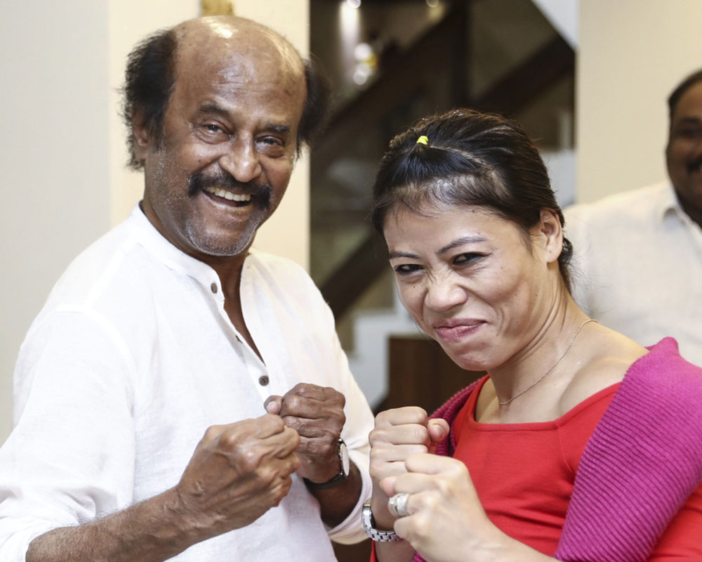 India's five-time Boxing champion Mary Kom called on superstar Rajinikanth at his Poes Garden residence in Chennai. Mary Kom was in Chennai - PTI