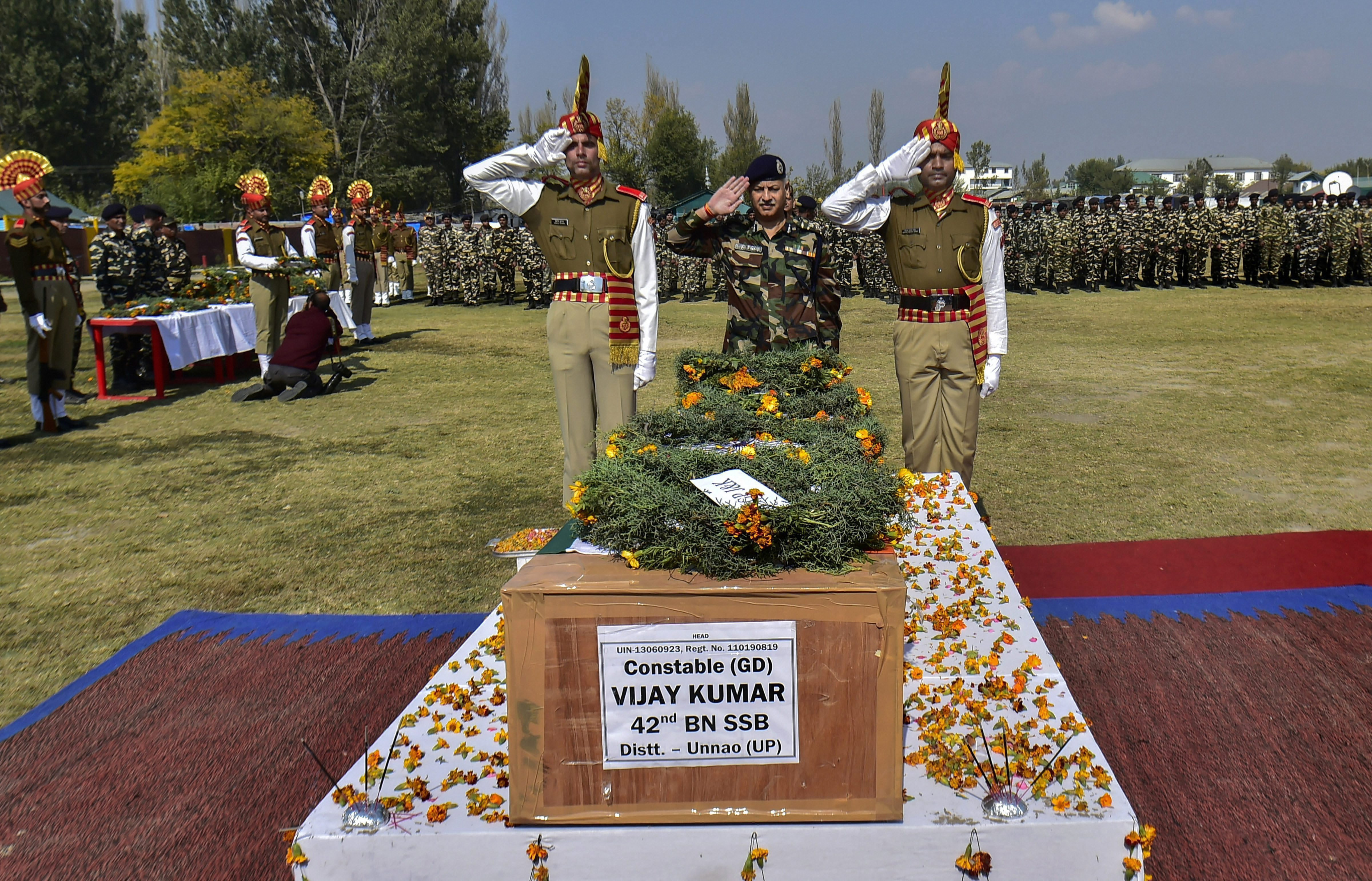 Senior Sashastra Seema Bal officers offer salute as they pay tribute to Sashastra Seema Bal's constable Vijay Kumar during a wreath-laying ceremony, in Srinagar - AP