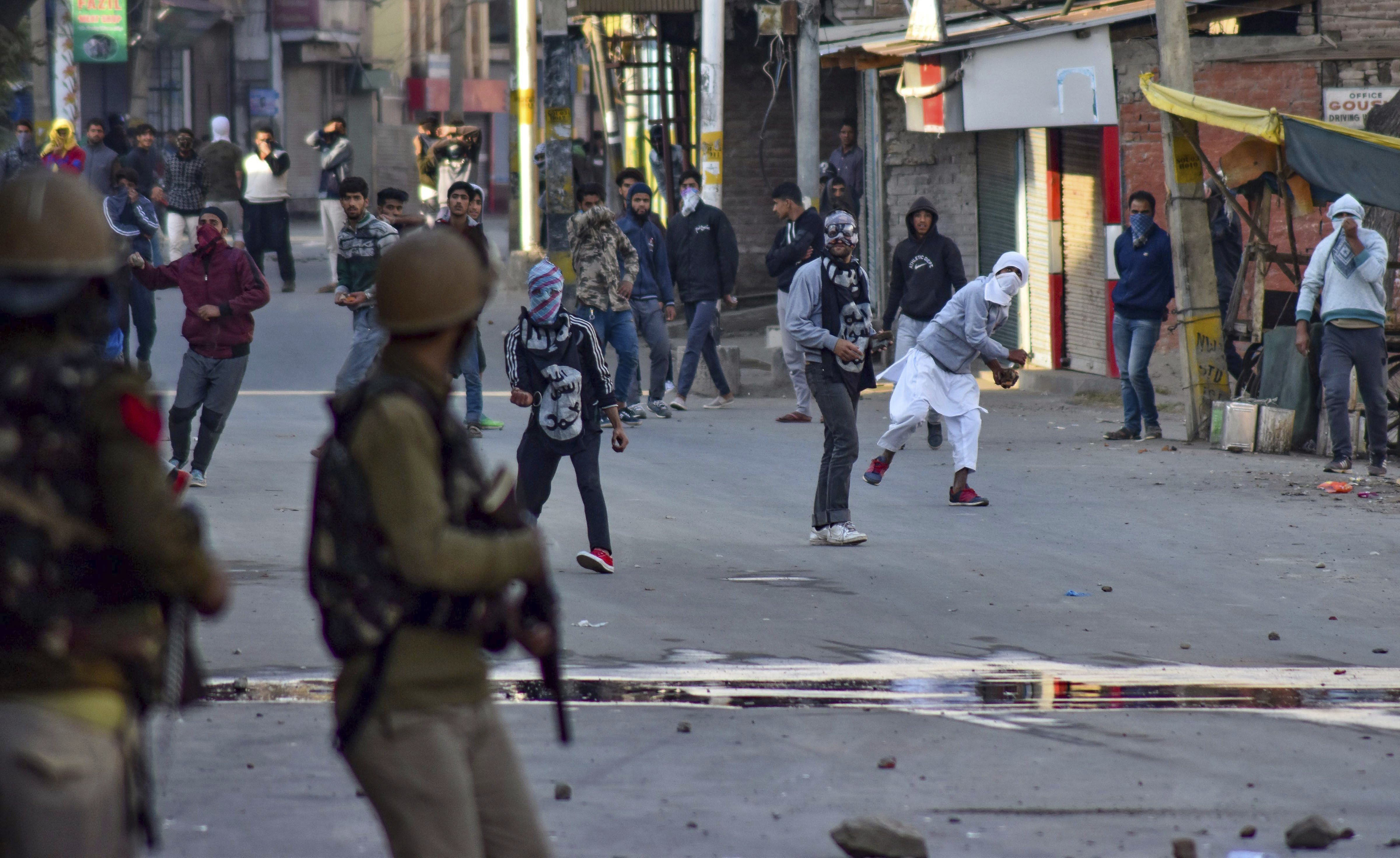 Protesters pelt stones at the police during a clash, in Srinagar - PTI