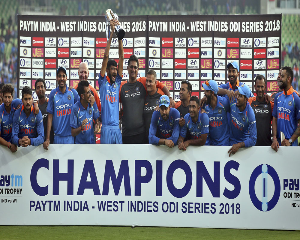 Indian Cricket team poses with the trophy after winning the 5th and final ODI cricket match against West Indies, at Greenfield International Stadium in Thiruvananthapuram - PTI