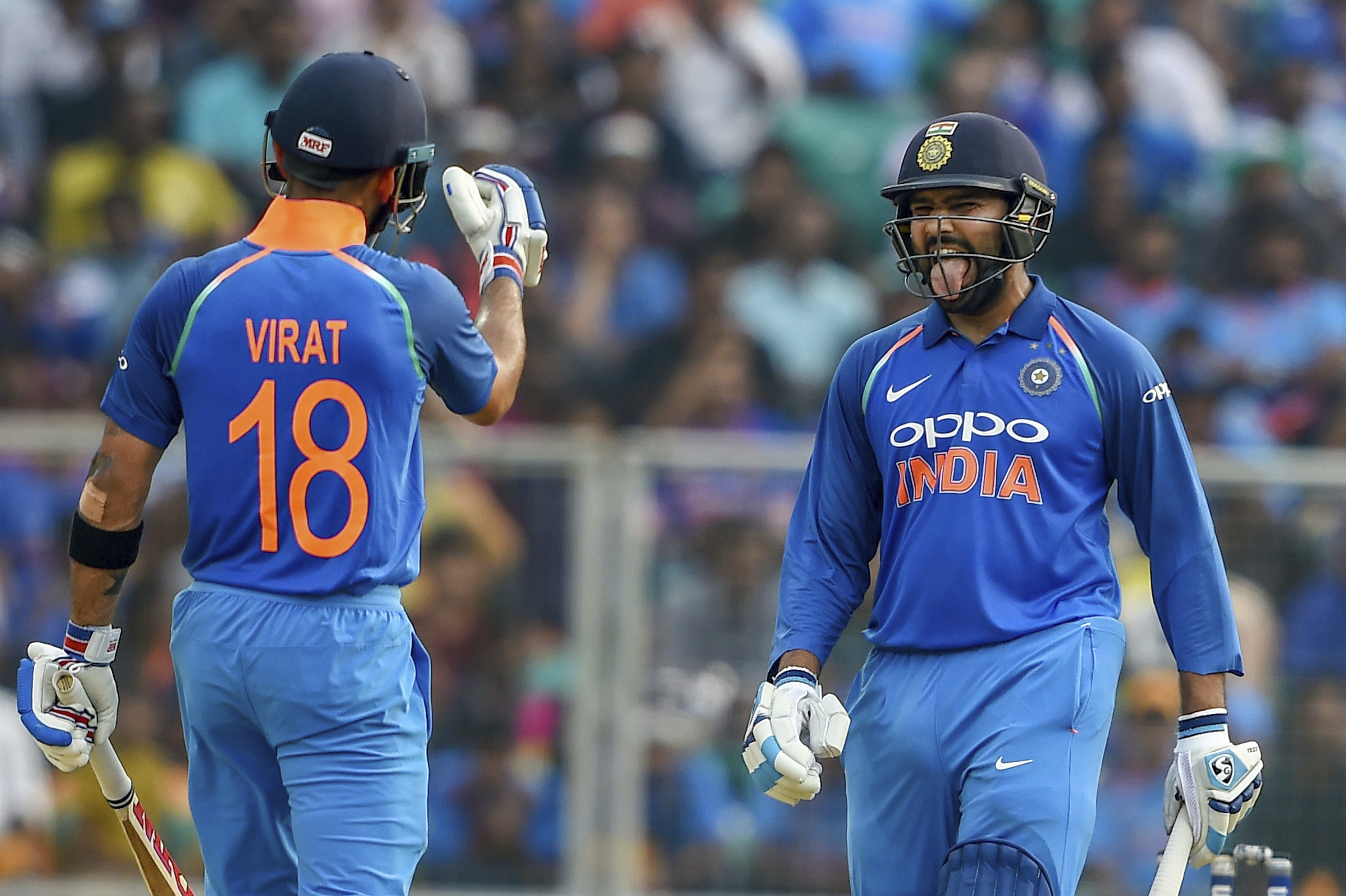 Indian batsman Rohit Sharma, right, gestures to captain Virat Kohli after hitting a boundary during the 5th and final ODI cricket match against West Indies, at Greenfield International Stadium in Thiruvananthapuram - PTI
