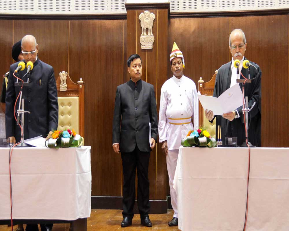 Justice Akil Abdulhamid Kureshi being sworn-in as the Chief Justice of Tripura High Court by Governor Ramesh Bais at Raj Bhawan in Agartala - PTI