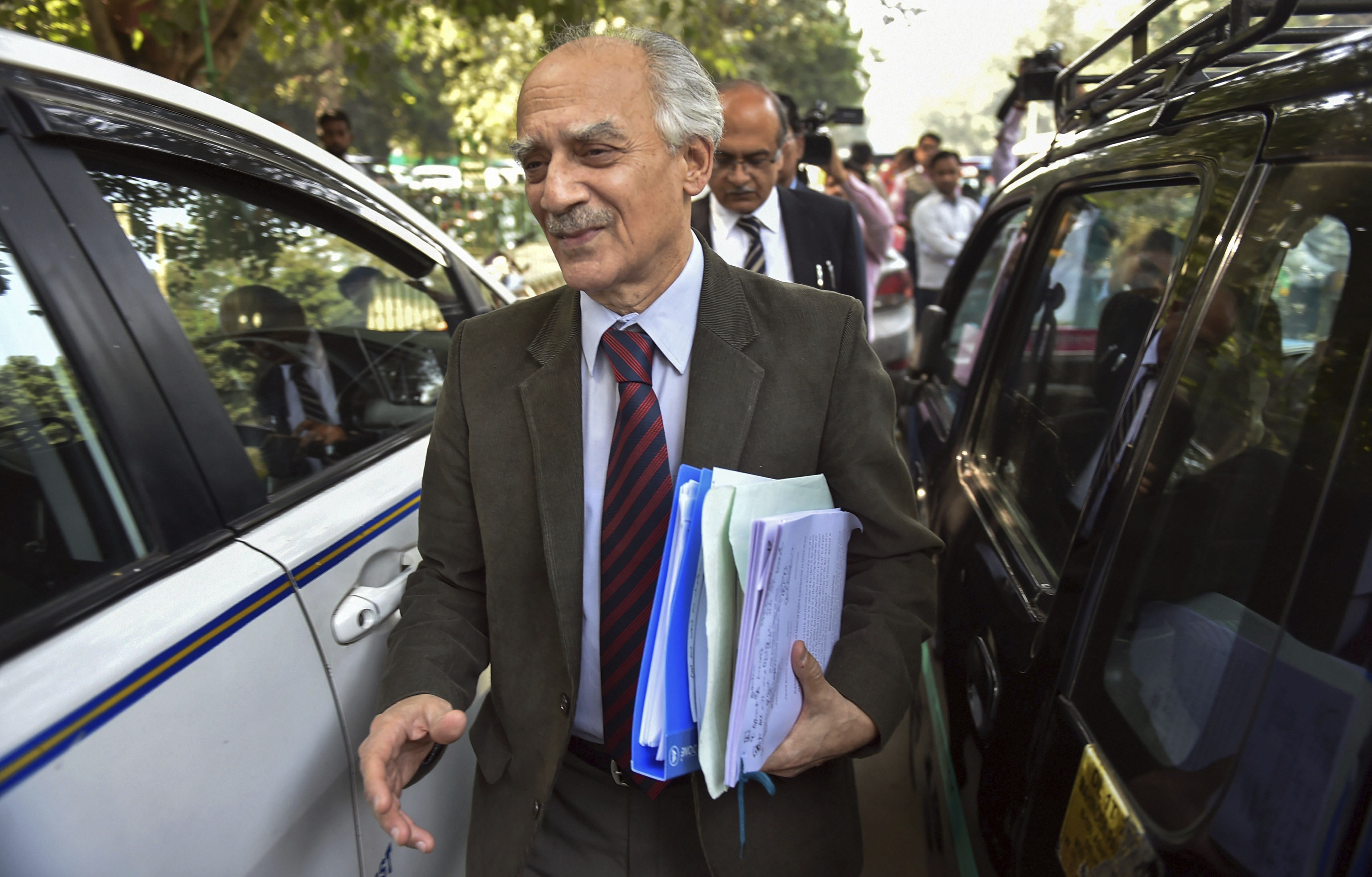 Former union minister Arun Shourie with Senior lawyer Prashant Bhushan leave the Supreme Court after a hearing on Rafale deal, in New Delhi - PTI
