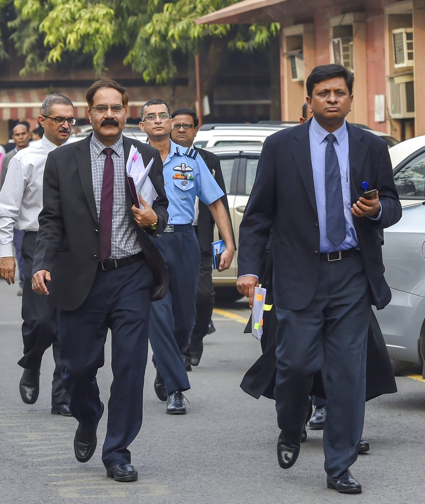 Apurva Chandra (R), Director General (Acquisition) of the Ministry of Defence, along with IAF officials leaves the Supreme Court after a hearing on Rafale Deal, in New Delhi - PTI
