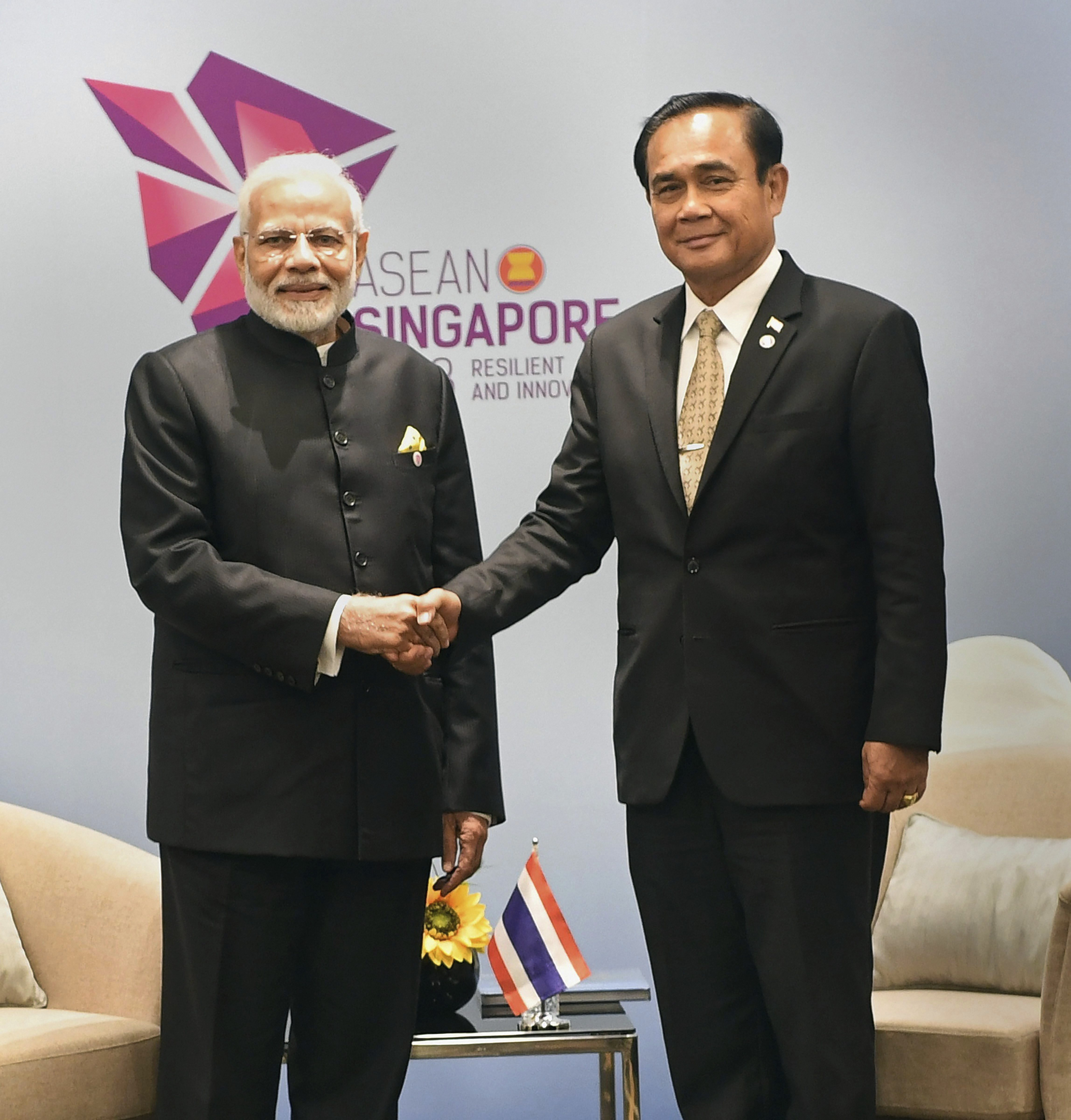 Prime Minister Narendra Modi shakes hands with his Thai counterpart General Prayut Chan-o-cha, on the sidelines of East Asia Summit, in Singapore - PTI