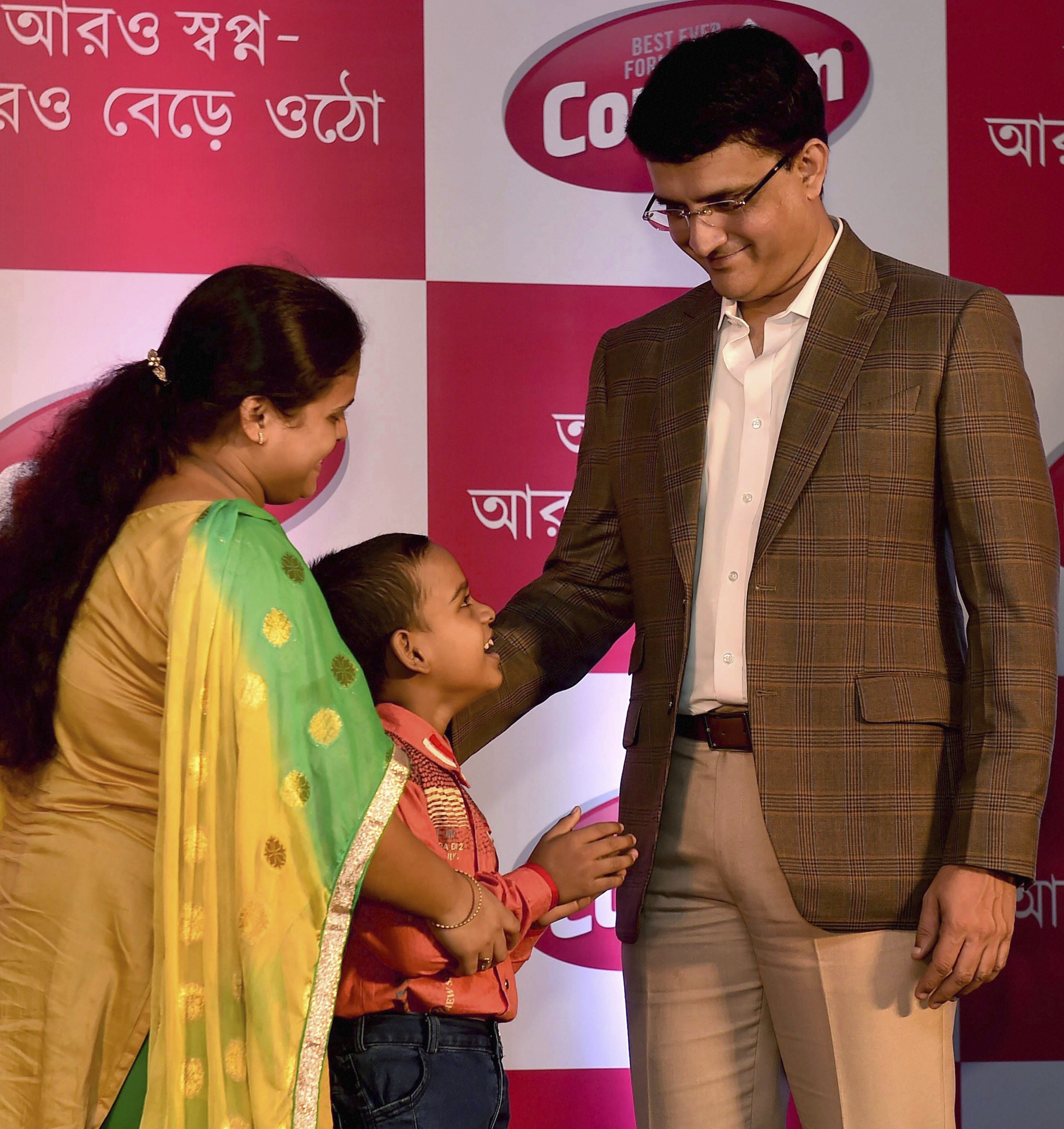 Former Indian cricket team captain and CAB (Cricket Association of Bengal) President Sourav Ganguly interacts with a child during a promotional event in Kolkata - PTI