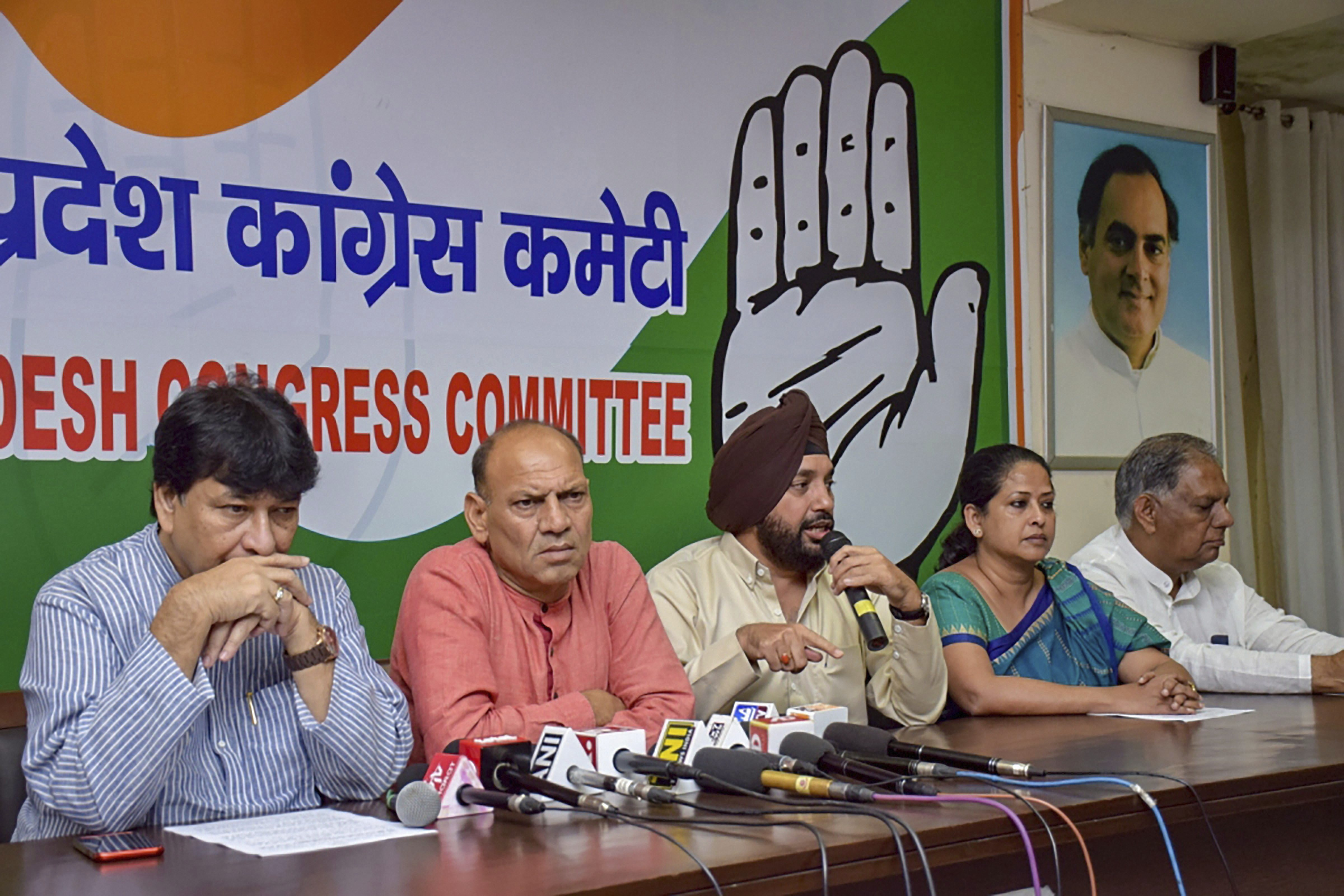 Senior Congress leader Arvinder Singh Lovely, Haroon Yusuf and former Delhi MLA Mukesh Sharma during a joint press conference, in New Delhi - PTI