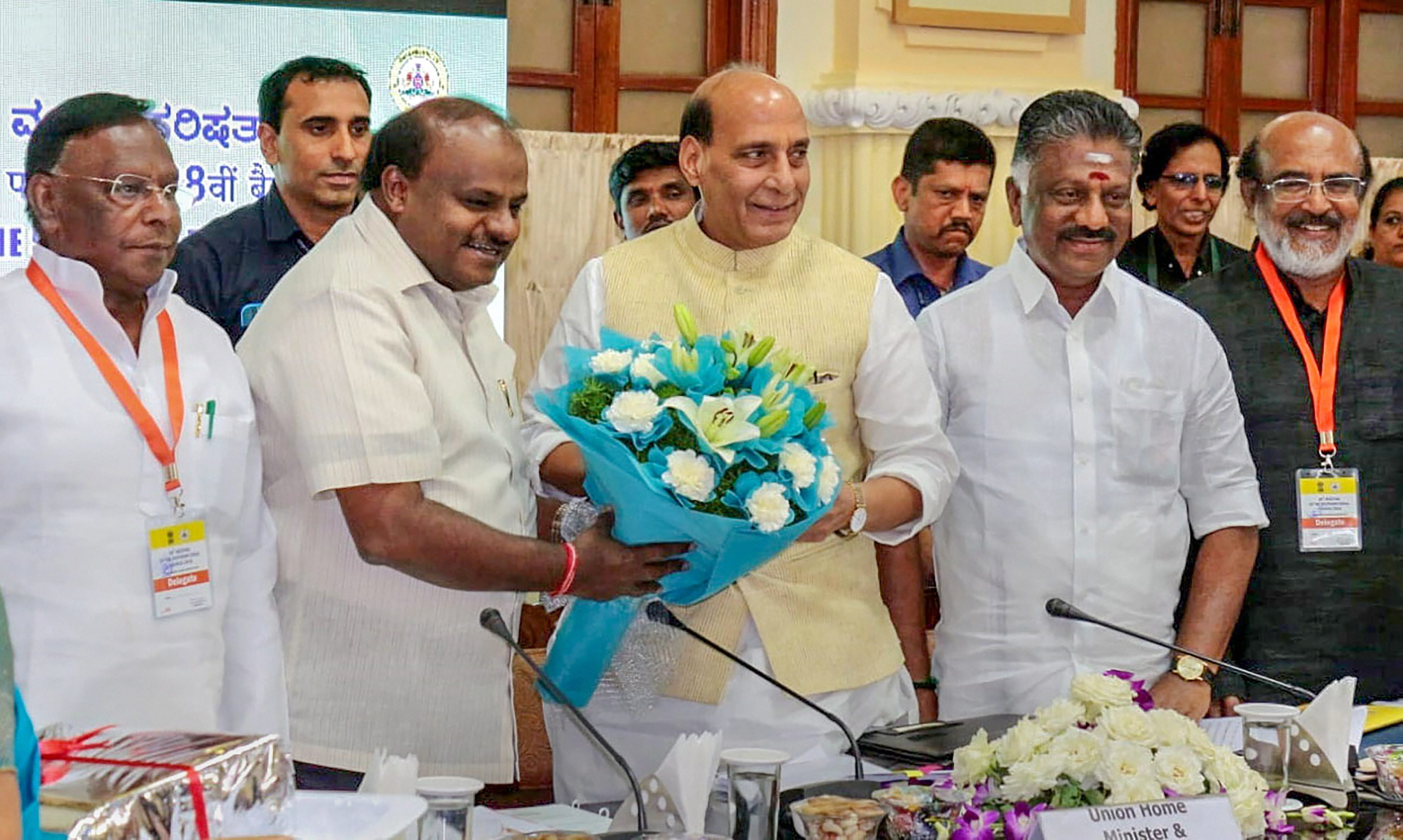Union Home Minister Rajnath Singh being welcomed by Karnataka Chief Minister H.D. Kumaraswamy at the 28th Meeting of the Southern Zonal Council, in Bengaluru - PTI