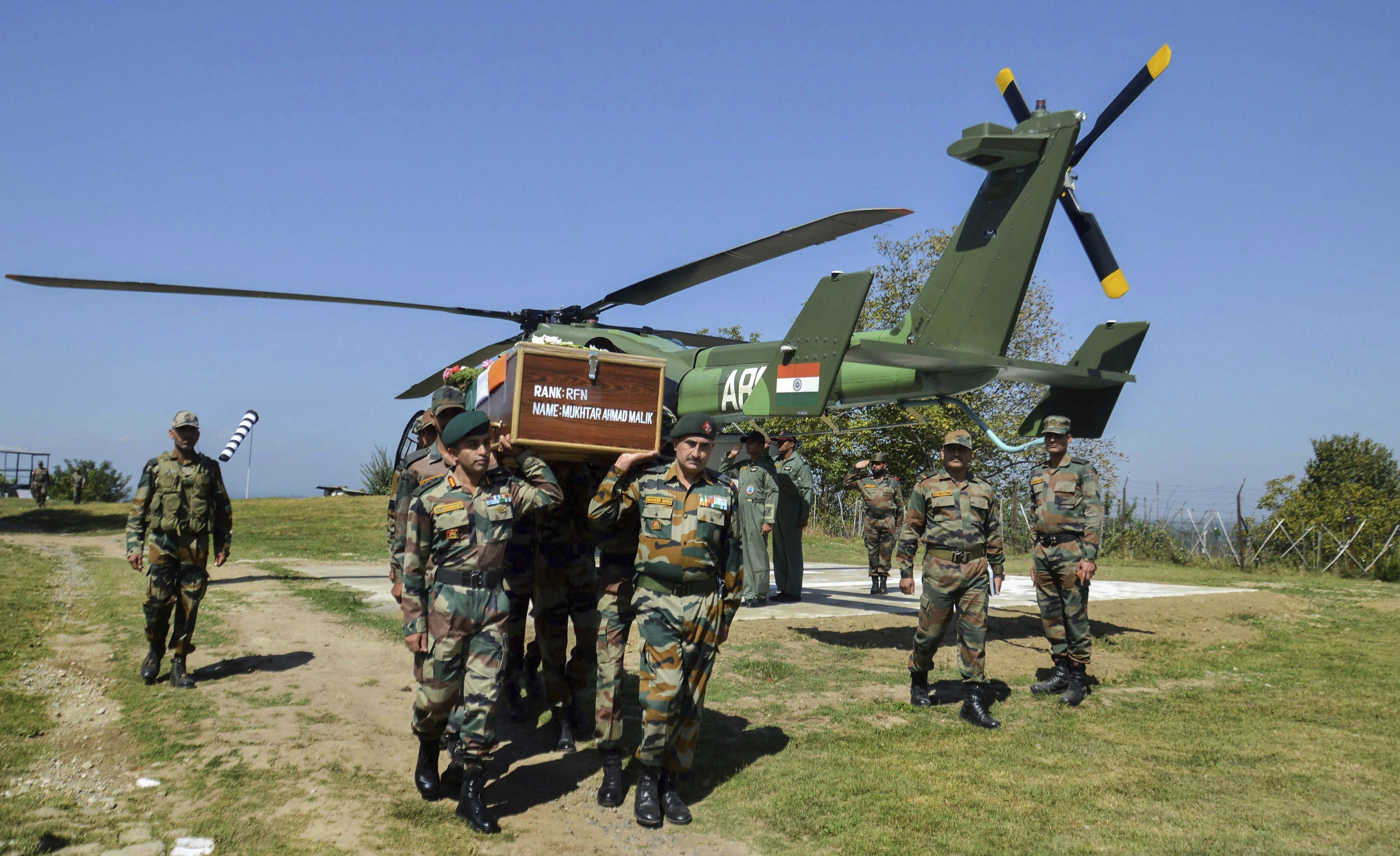 Army personnel carry the body of Lance Naik Mukthar Ahmad Malik during his funeral at his native village in Kulgam district of south Kashmir - PTI