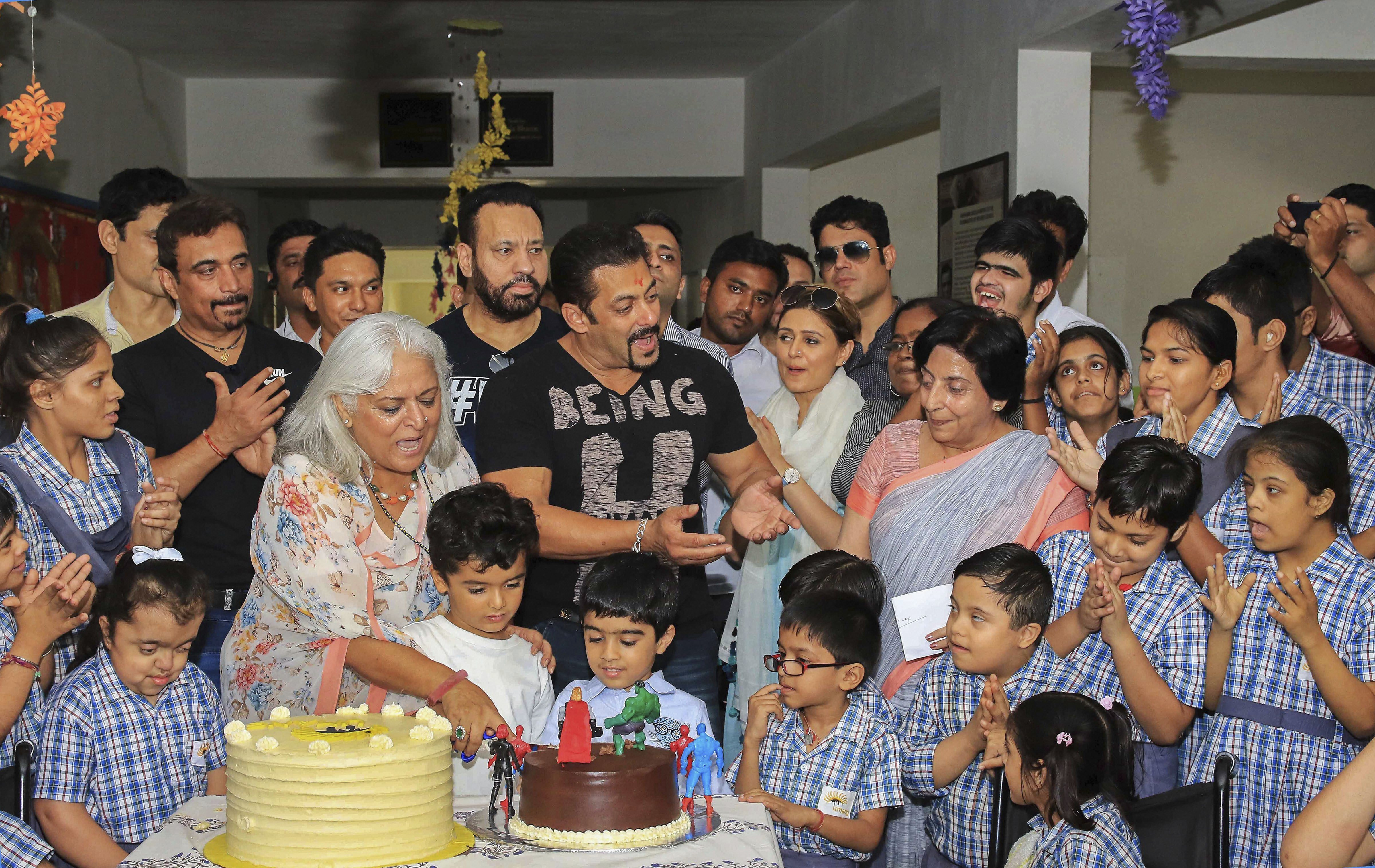 Bollywood actor Salman Khan and former Rajasthan tourism minister Beena Kak cut cakes during the inauguration of 'Umang' centre for the special children, in Jaipur - PTI