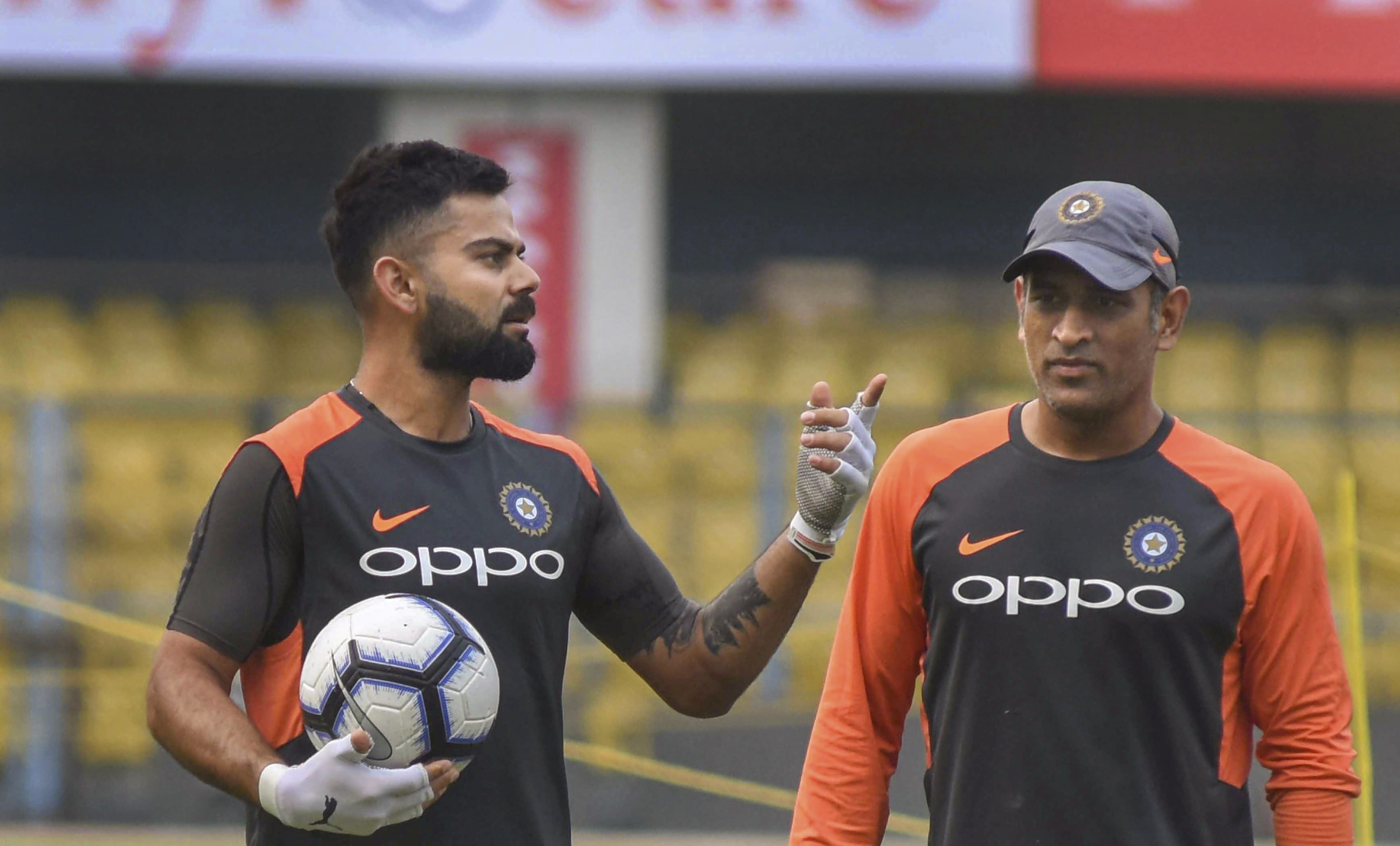 Team India captain Virat Kohli and MS Dhoni during a practice session ahead of the first One Day International cricket match against West Indies, at ACA Cricket Stadium, Barsapara in Guwahati - PTI