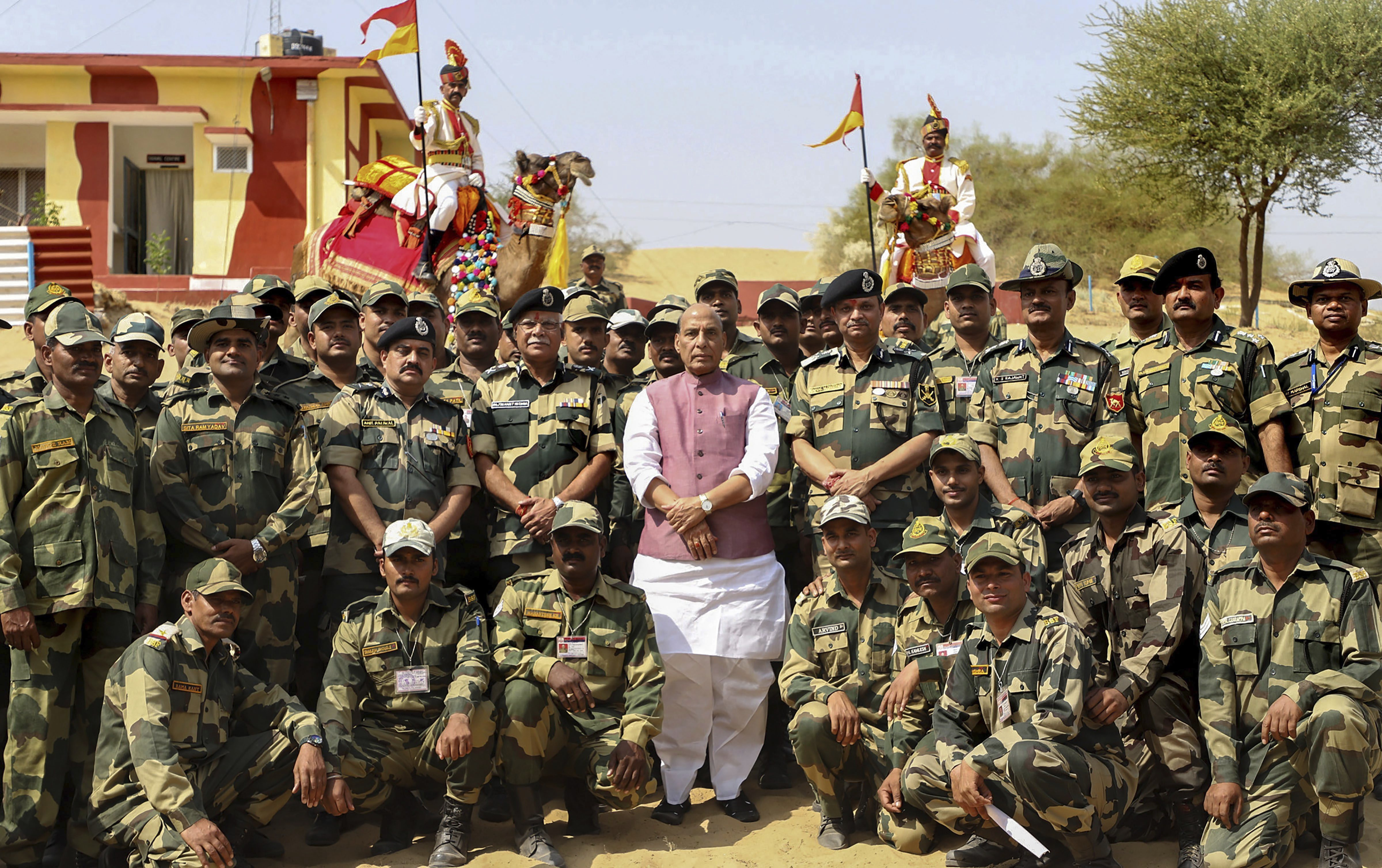 Union Home Minister Rajnath Singh in a group photograph with BSF personnel at a border outpost, in Bikaner, Rajasthan - PTI
